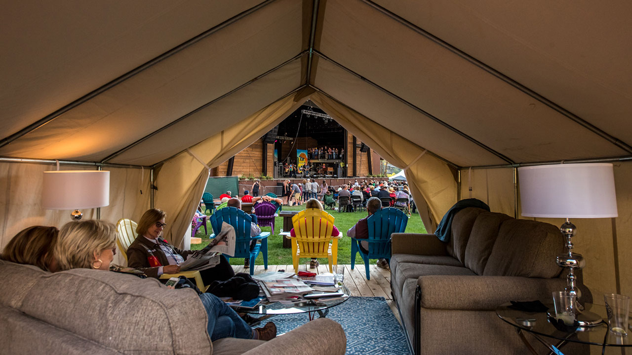 Comfortable furniture and cozy decor makes for a welcoming and warm festival home-base for the weekend for your group of close friends.