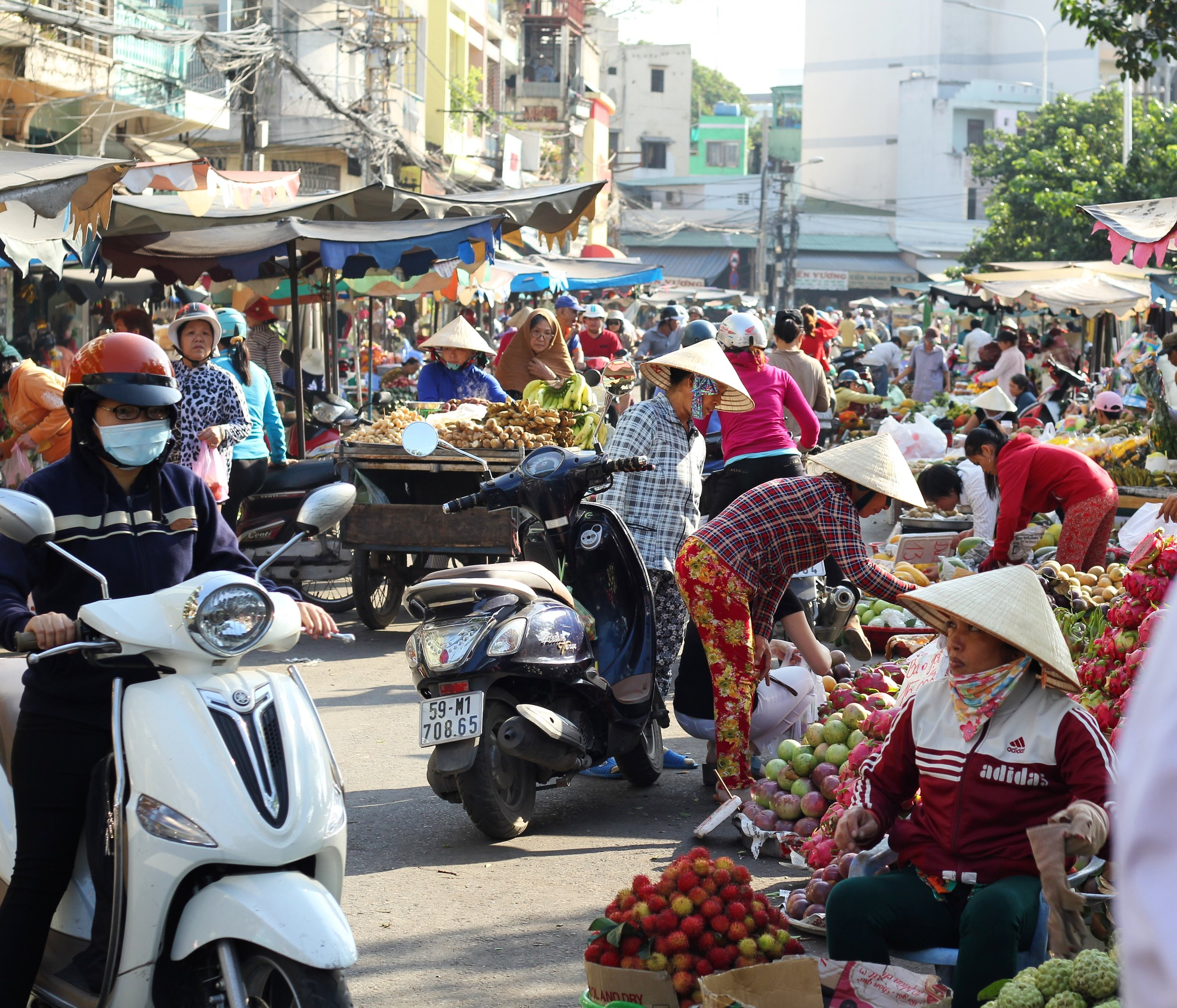 The bustling morning market in the Cholon District of Ho Chi Minh City.