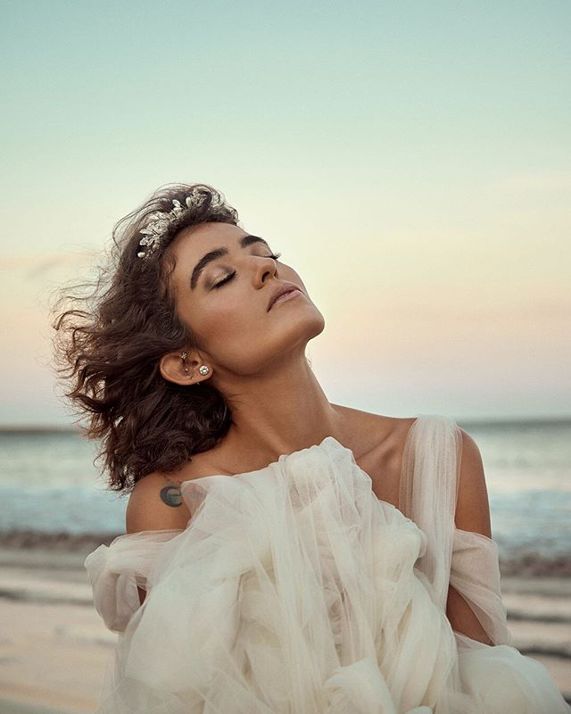 A head full of dreams. - Model: @meganorozco.official  Hair: @bri_oro  Makeup: @beeprettymakeup  Dress: @priveweddingdesigns  Photo: @marcusroyhoffman . . . . #bridalfashion #beachbride #bridalportraits #beachweddings #sunsetbeach #portrait_mood #moodywedding #portrait_page #ig_portraits #manhattanbeachphotographer #redondobeachphotographer #hermosabeachphotographer #palosverdesphotographer