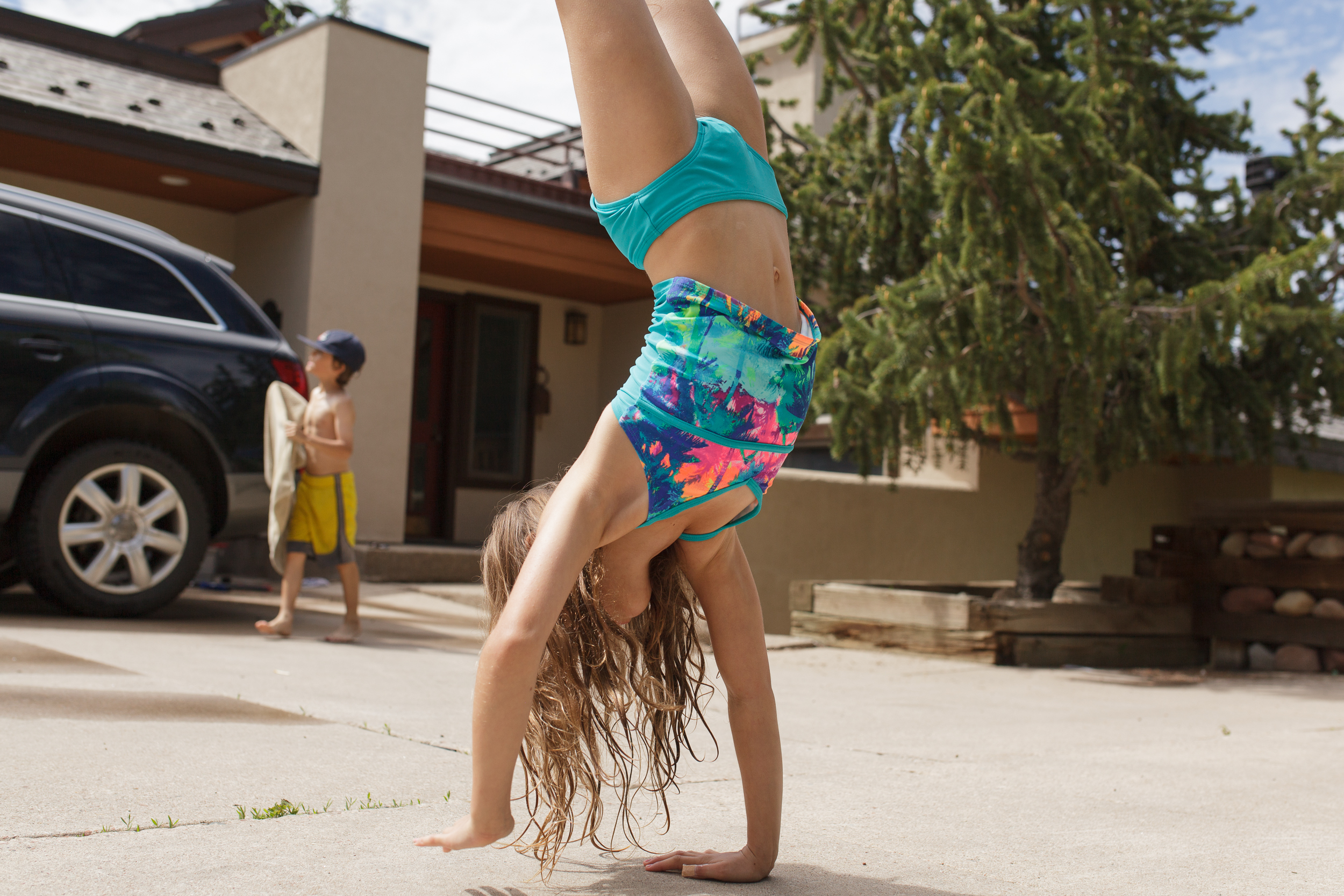 I always want to remember her obsession with handstands!  Washing the car was a novelty that first summer.