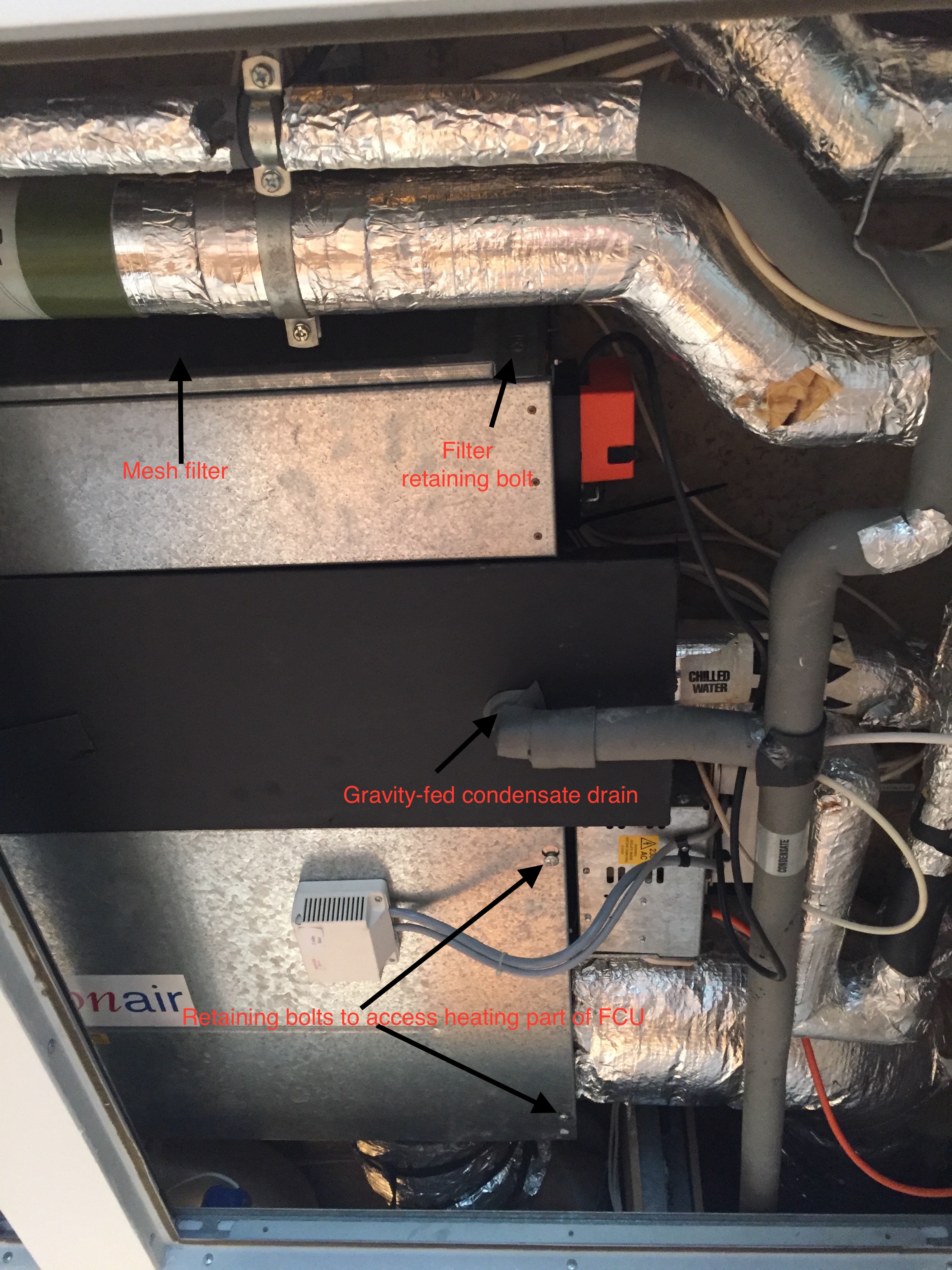 view of an fcu through an open ceiling panel