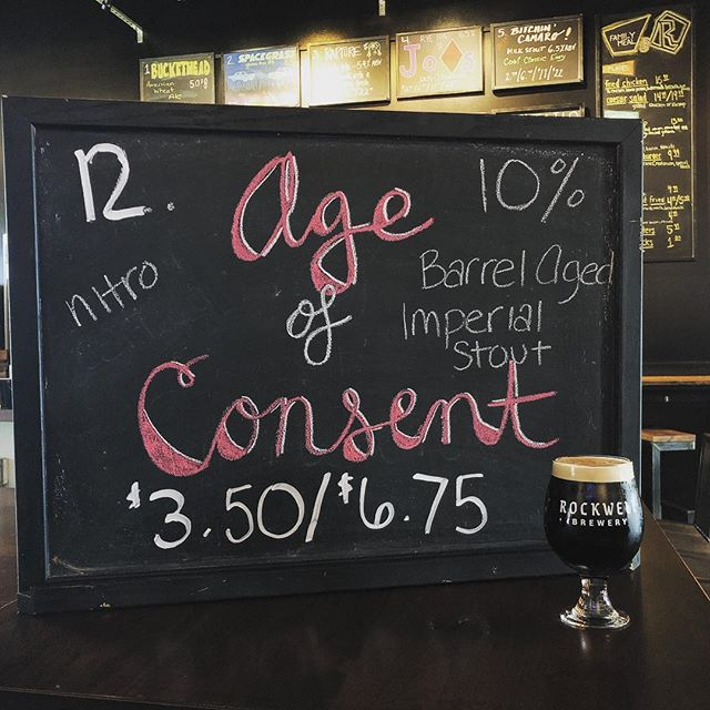 🍺BEER RELEASE!!!🍺 Age of Consent ✨ Clocking in at a whopping 10%, this barrel aged imperial stout is darknesses best friend. This bad boy sat for 6 months in a @catoctincreek rye whiskey barrel and has a very smooth finish! 🥃🍺 We're open 12-10 today! Come in for lunch, dinner, or both! You don't want to miss it! . . . . . . . #beerwell #drinklocal #downtownfrederick #frederickbeer #frederickmd #rockwellbrewery #barrelagedbeer #imperialstout #lit