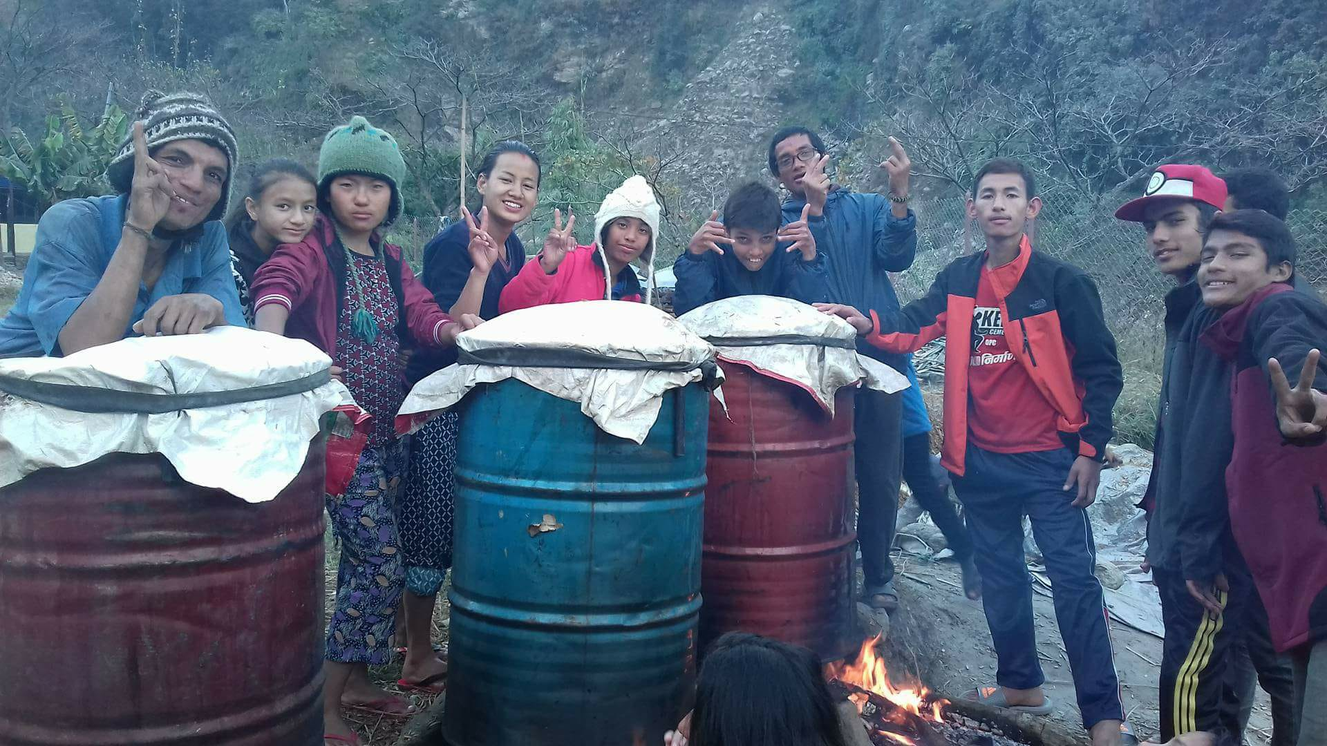 Students boiling hay which will be used as the substrate in which the mushrooms will grow