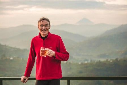 Paul celebrating a welcome pint after the longest climb of the week
