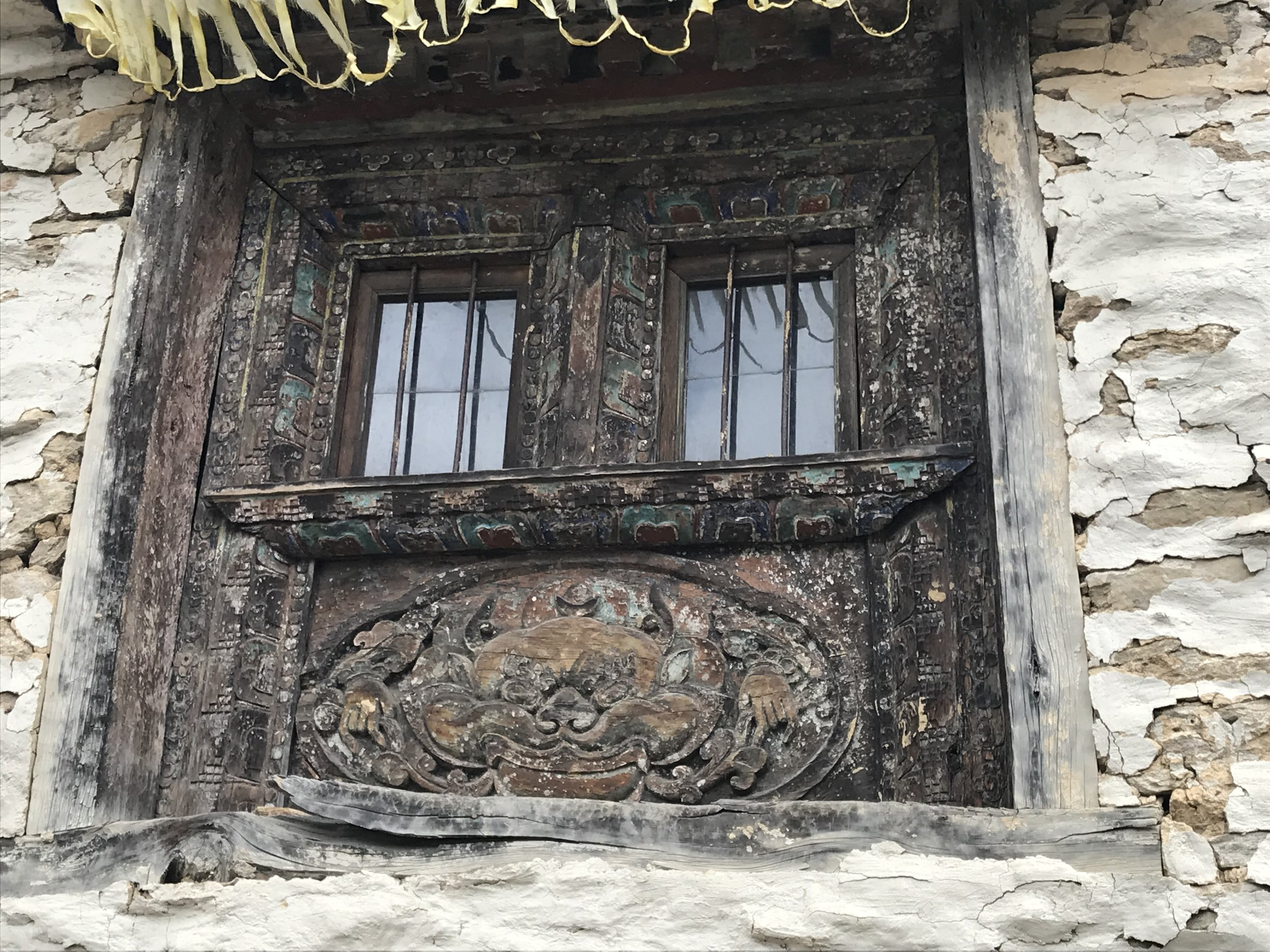 Detailed image of intricate carving of Gompa window