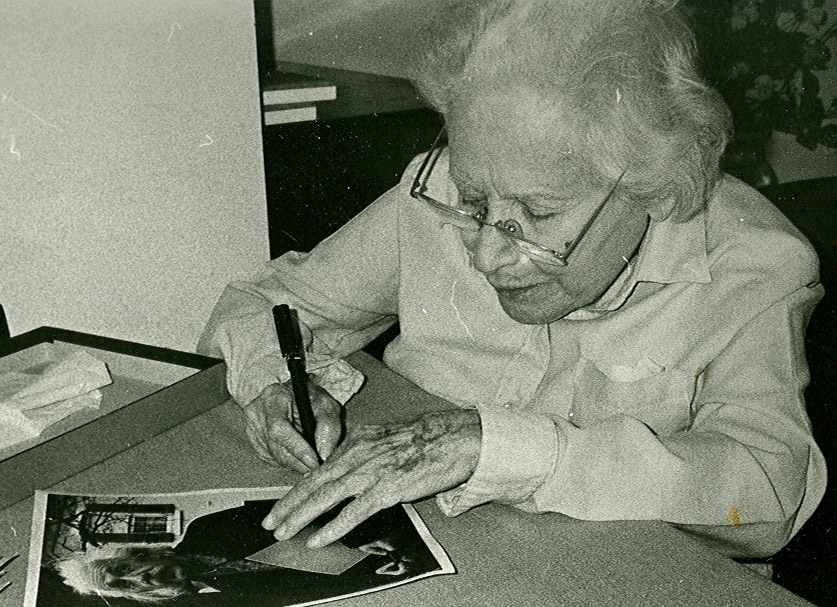 Paul signing her Einstein photo