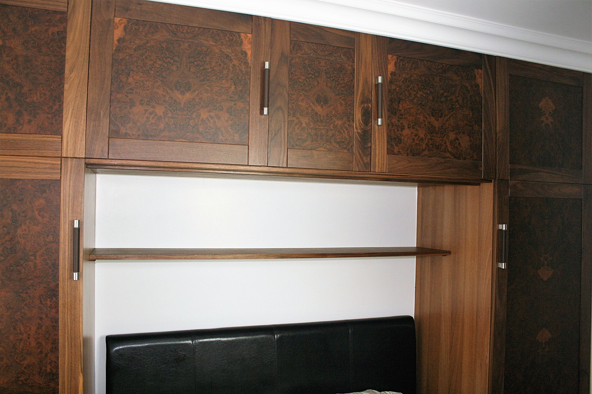 Bedroom wardrobes in black walnut and walnut burr