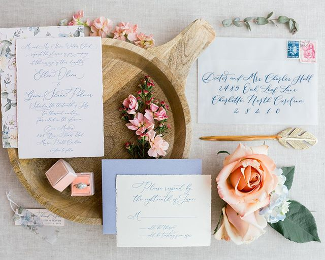 I received some gorgeous photos back yesterday for a vintage, French Country invitation suite! I am seriously blown away 💙 this suite had a pale pink invitation card with torn edges and a full watercolor florals backer, a cream RSVP card with torn edges, a dusty blue RSVP envelope, and my favorite, a translucent vellum main envelope 😍Swipe to see the full vellum envelope effect (my photo styling is nowhere near the talents of @sarahduckworthevents & @samanthalaffoon) and contact me if you'd like to do something similar with your invitations! 🎉💍 Venue: @dovemeadowsnc | Photo: @samanthalaffoon | Stationery & Calligraphy: @oceanandcoralcreative | Design: @sarahduckworthevents | Floral: @weddingswithbarbara | Beauty: @calistott_artistry | Dress & Accessories: @haydenoliviabridal | Groom: @menswearhouse | Rentals: @evermoreeventco, @nuagedesignsinc & @partytimerentals | Cake: @daphnessbakery