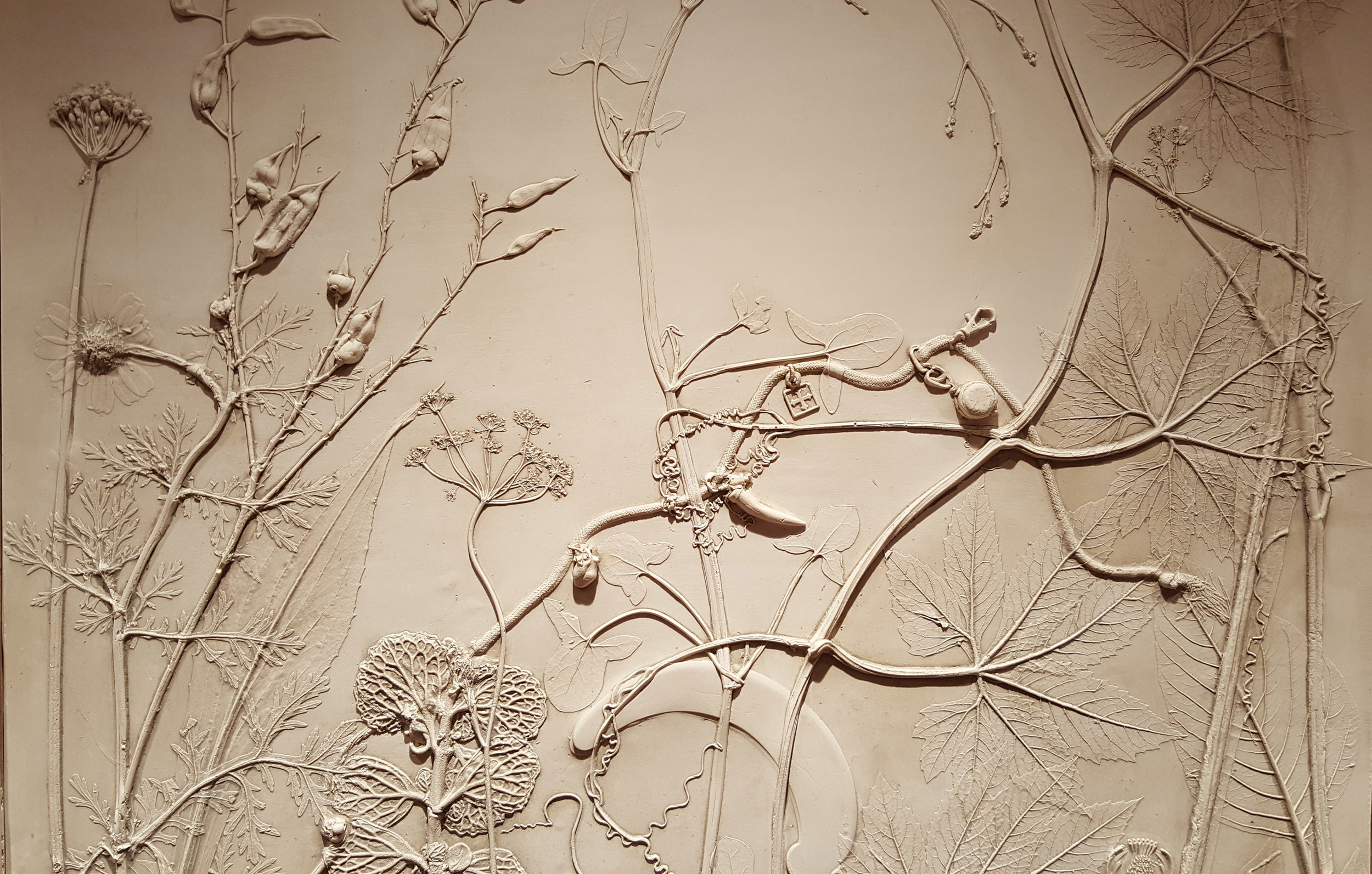These White Walls gathered treasured objects from the client to be cast within the mural, hidden amongst the weeds