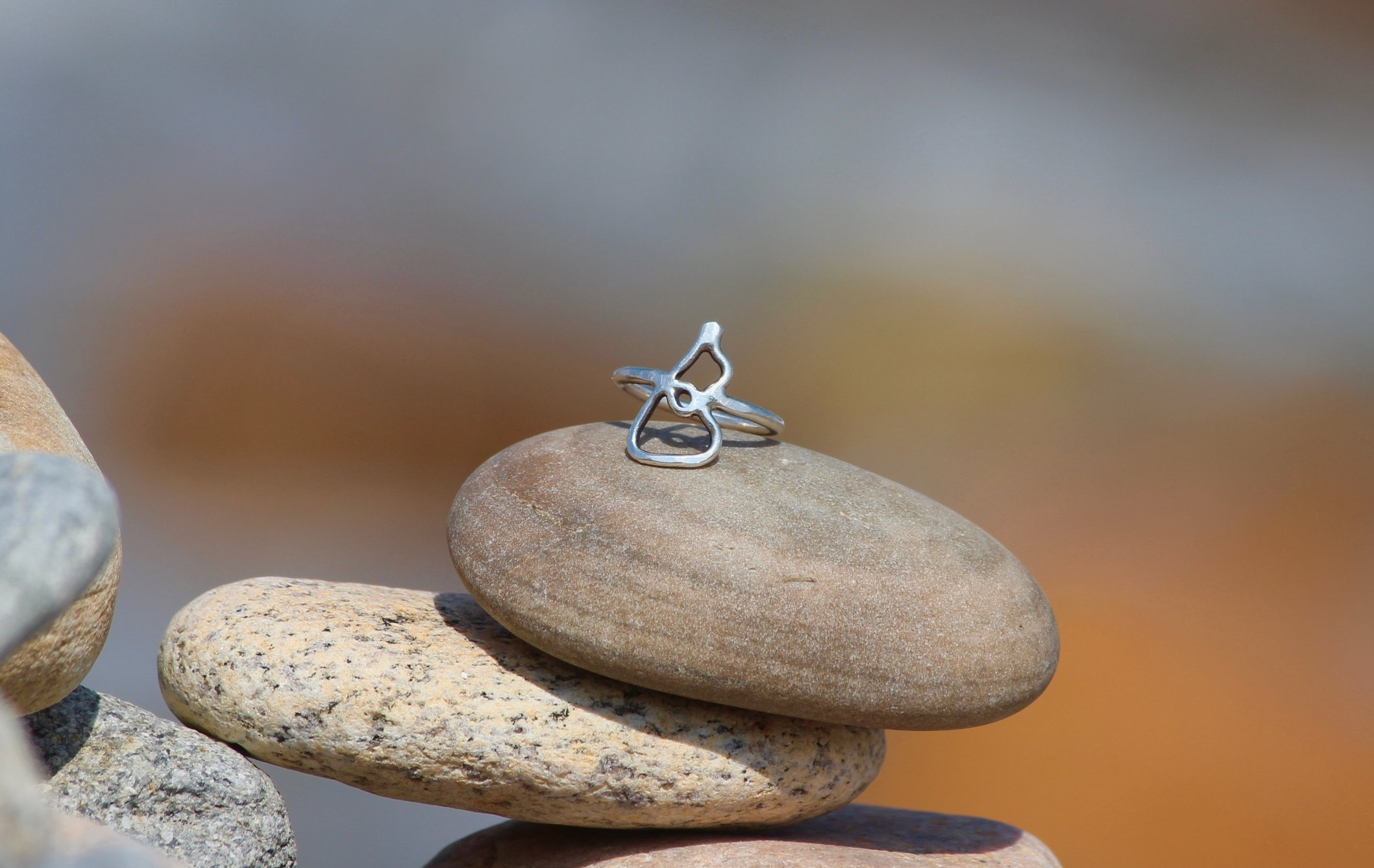 Sterling silver ring in the shape of the Island by Peter Gibbons, find him online  Here.