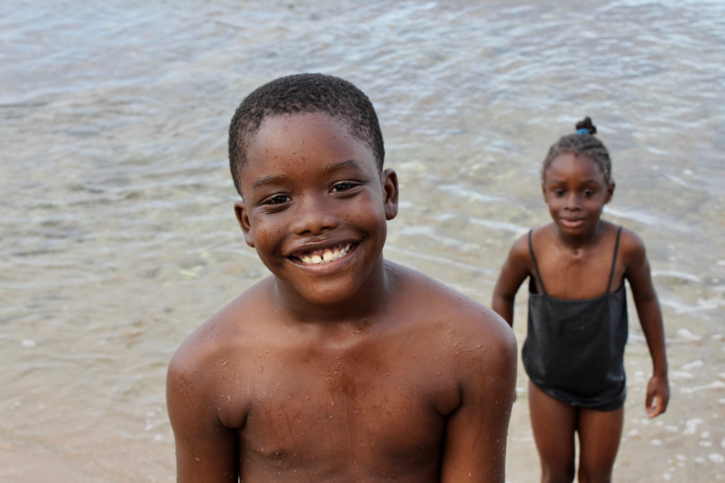 """I was taking pictures on the beach and he ran up to me and said """"cheeeseee"""" 😄 I took his picture, he said thank you, then ran away.   Bathsheba, Barbados"""