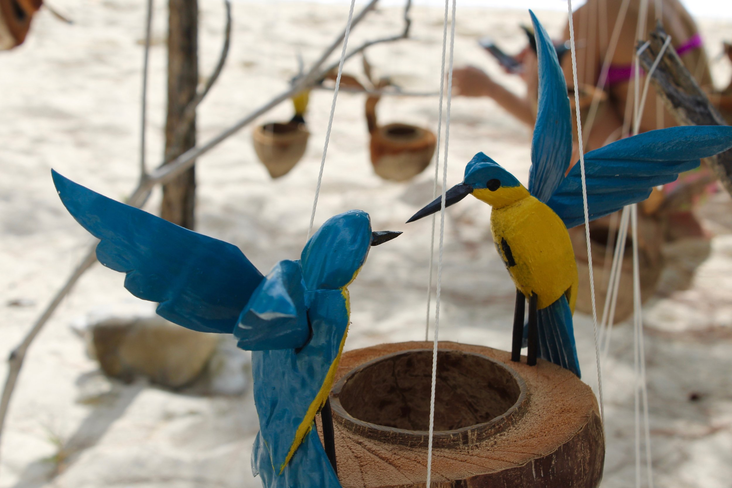 Barbados flag depicted on bird carvings