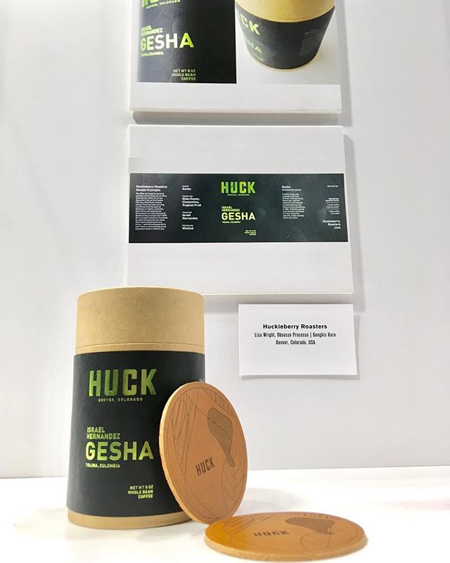 Our Gesha packaging for @huckleberryroasters was featured in the Design Lab exhibit at the @specialtycoffeeassociation #CoffeeExpo2019! ☕️ 💪 ☕️ Printed by @genghiskern . . . . . #specialtycoffee #coffee #huckleberryroasters #gesha #packagingdesign #design #letterpress #packaging #foil #teamworkmakesthedreamwork