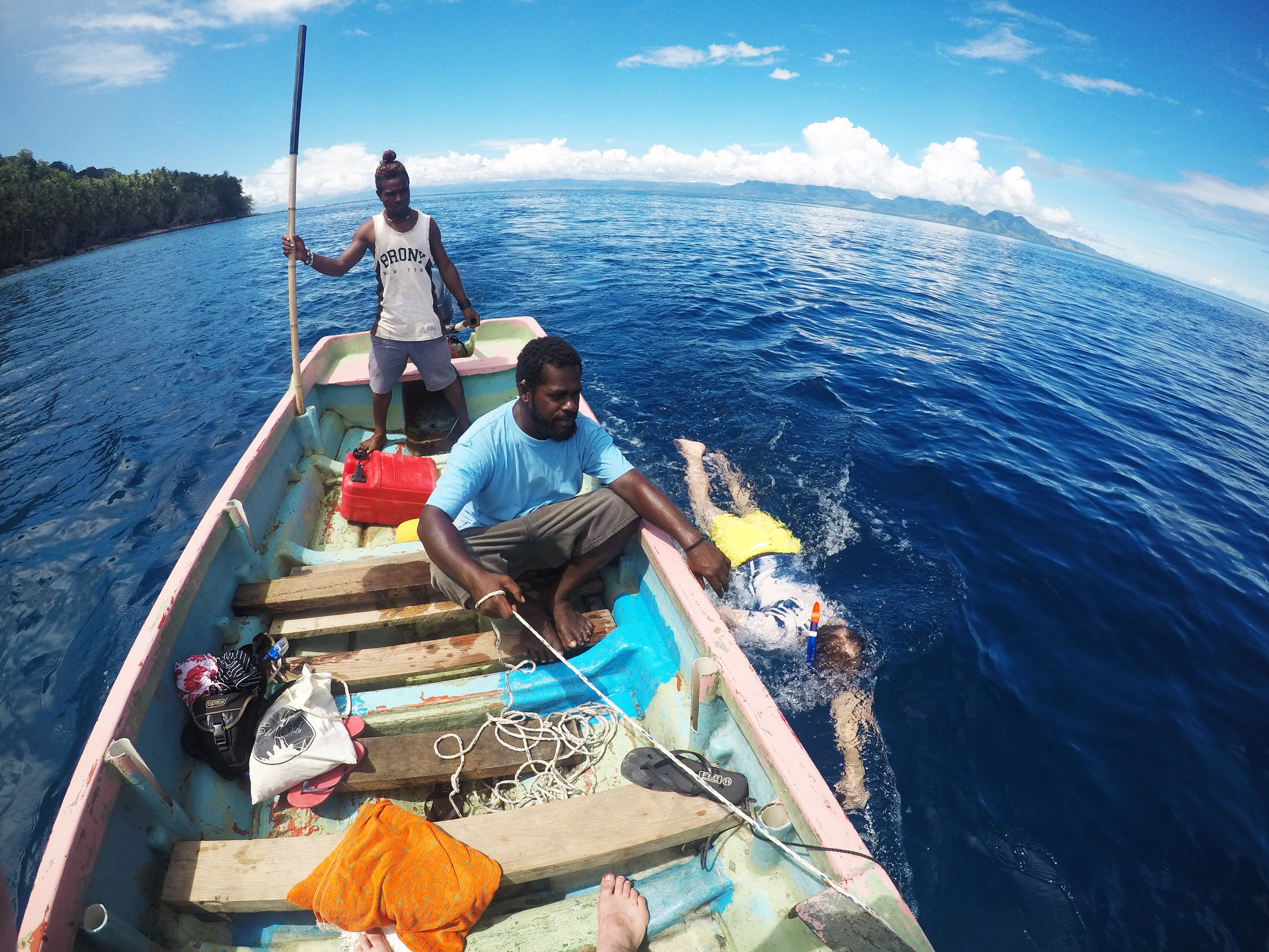Gordon under tow:  My ship-mate getting dragged along side the banana boat under the watchful-eye of our guides.