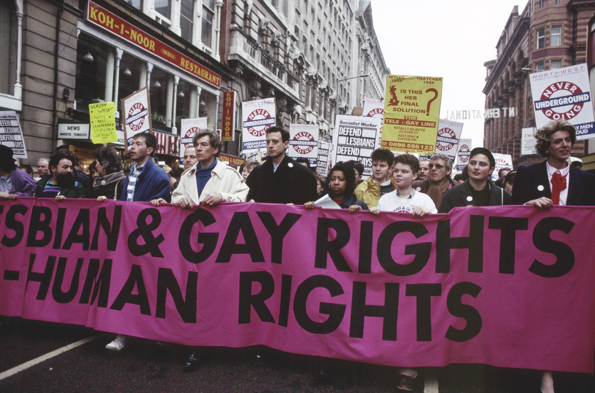 Sir Ian McKellen, Peter Tatchell & Louise Wellwein (pictured third from the right in the white) in Manchester on March Against Section 28, February 1988. Photography: Alamy Stock Photo