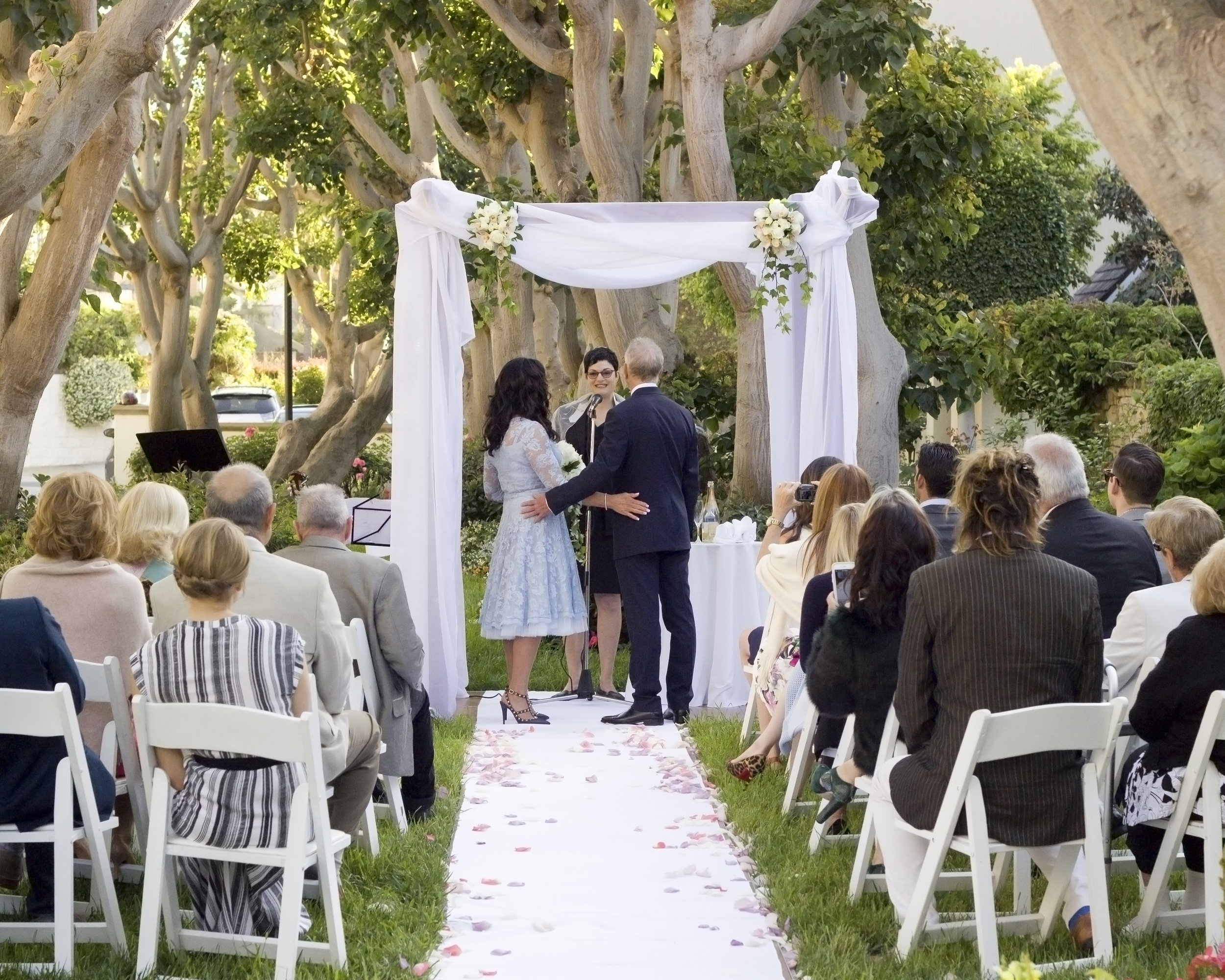 Rabbi Avivah officiates a summer wedding in Marina del Rey, Calif.
