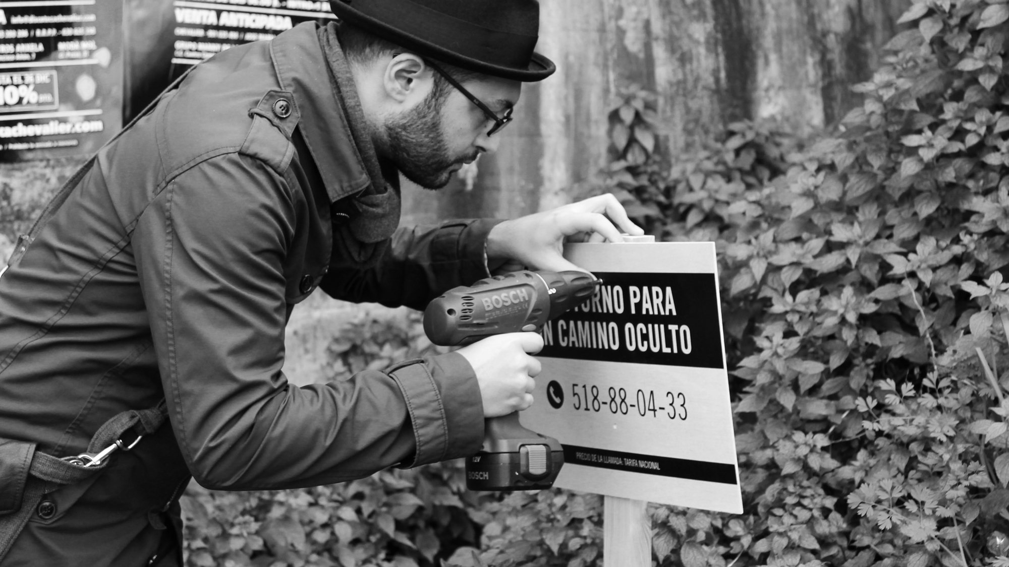 Production: Installing a sign on a hidden path
