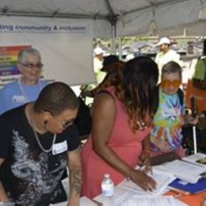 Linda helping out in the Proud & Included Booth at the 2017 Disability Pride Parade