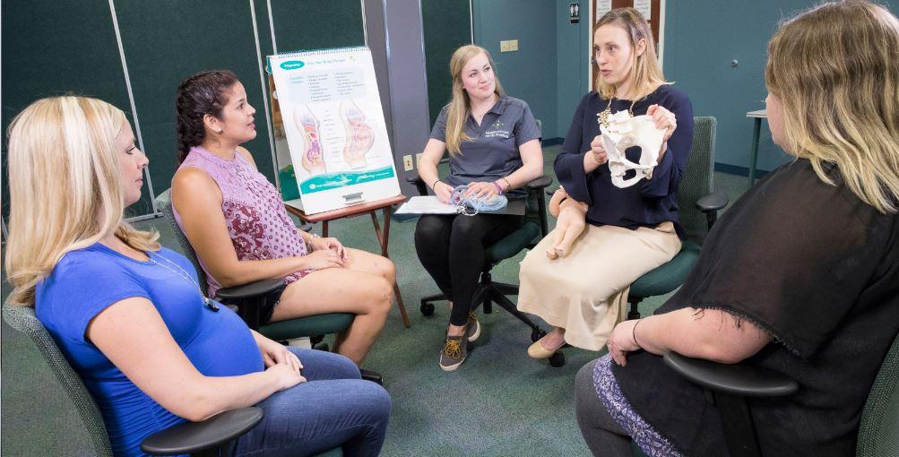 Karen (left in pink) attends CenteringPregnancy®