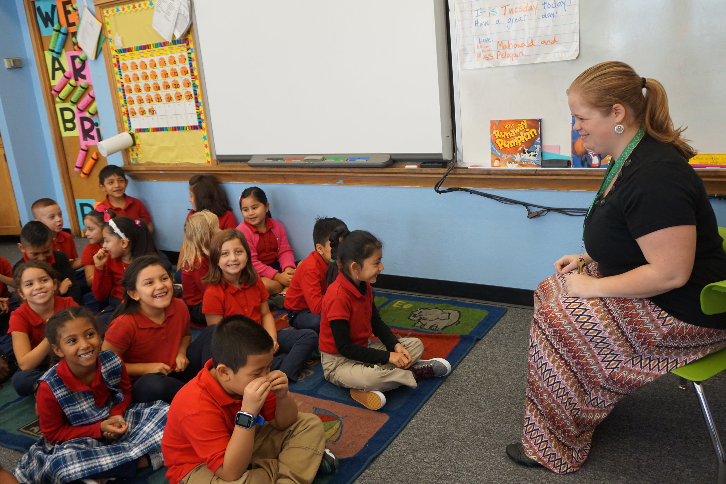 Educator Betsy Peloquin with her class of students at St. John Paul II Catholic Preparatory School.