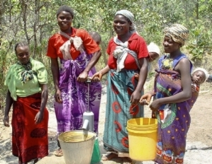 Actual village women and babies in Malawi that have benefited from clean water through B1G1.