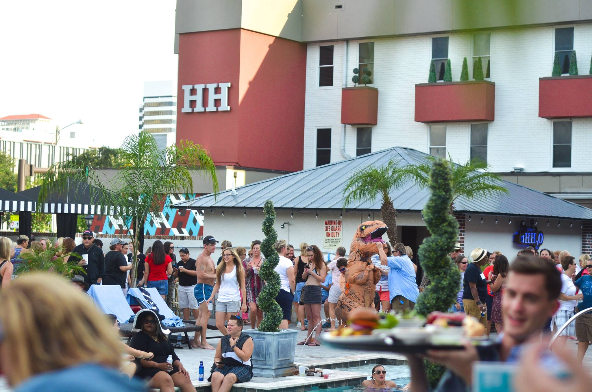 Crowd of people hanging out in the pool area