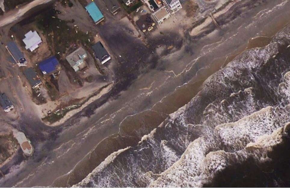 Dunes in North Topsail Beach were washed over and the sand was transported landward during Hurricane Florence, covering the road and driveways. Photo: U.S. Geological Survey