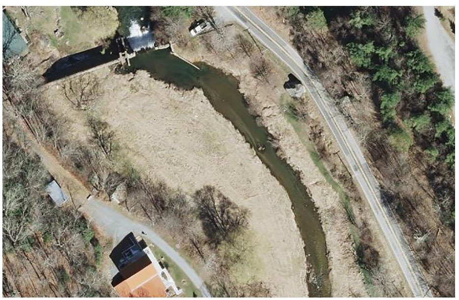 This aerial photo displays the section along Payne Branch Road in Blowing Rock where the stream will be restored. The decommissioned Payne Branch hydroelectric dam, visible in the upper left corner, will be removed as part of the restoration efforts. Photo submitted