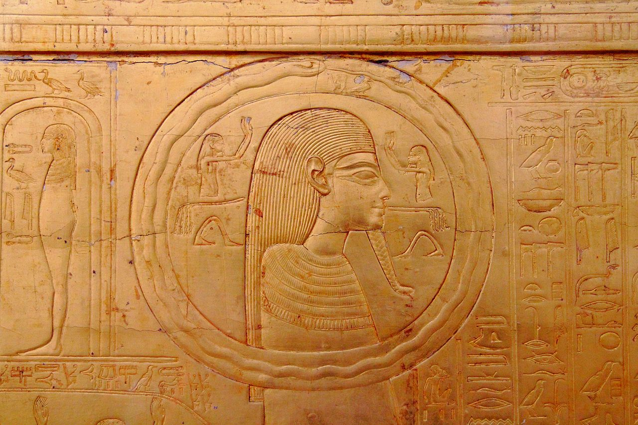First known representation of the ouroboros on one of the shrines enclosing the sarcophagus of Tutankhamun