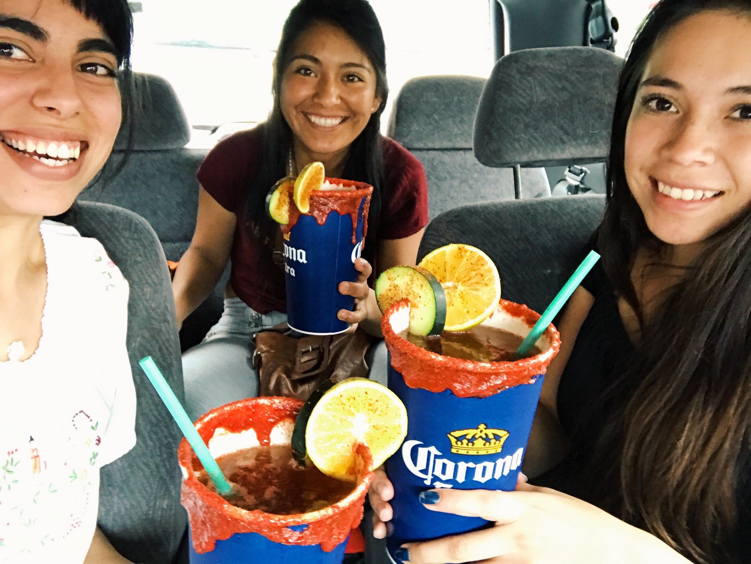 DESSERT!  Micheladas      with my cousins! It is beer with tamarind flavoring and a candy paste and chili ring... mmmm!