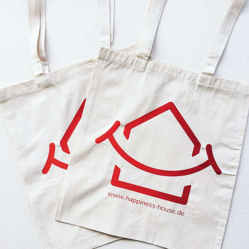 Screen-printed, custom-made tote bags. Client: Happiness House