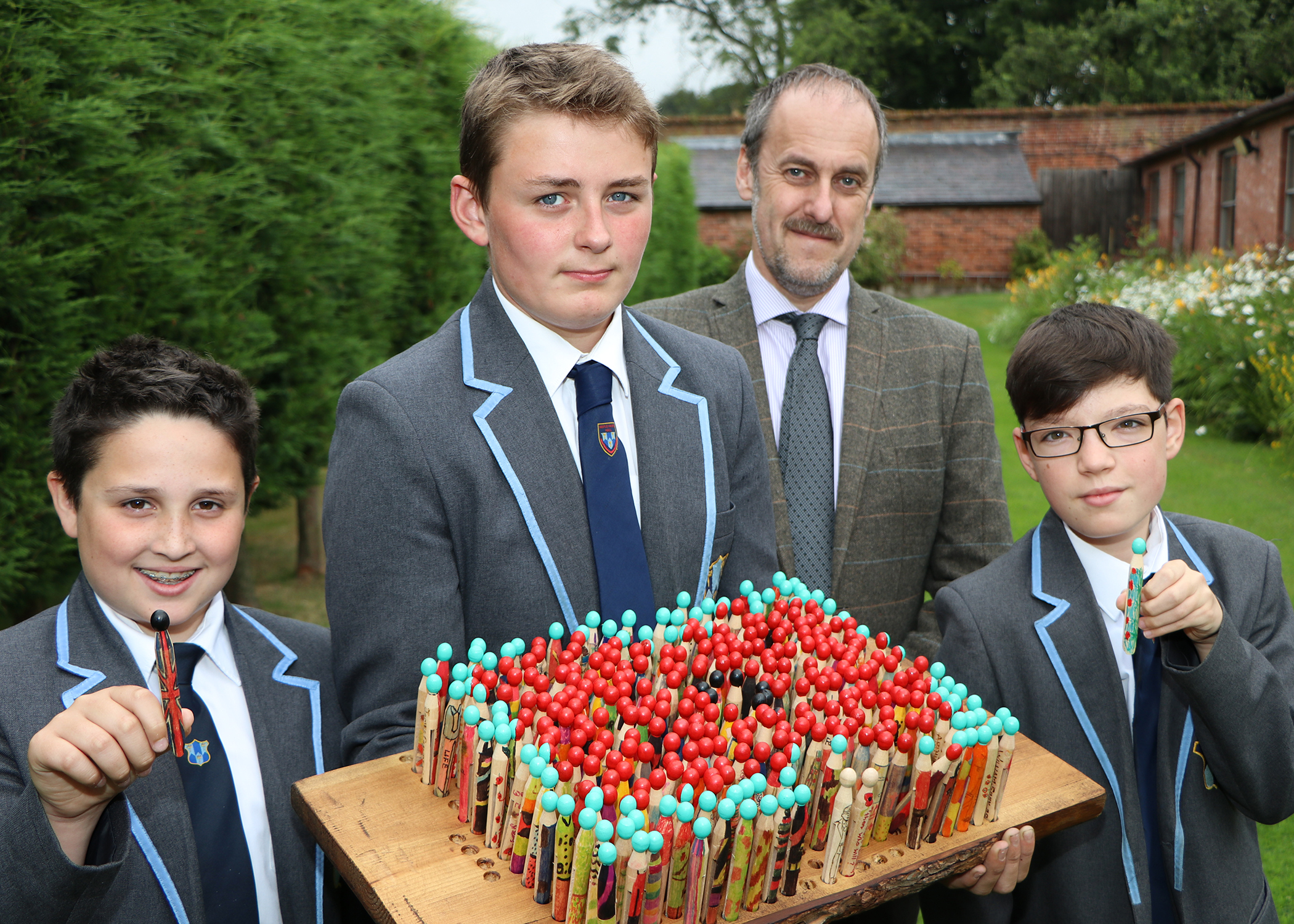 Maple Hayes pupils taking part in Shot at Dawn project - Left to Right: Tom Powers, Henry Tomlinson, Dr Daryl Brown, Alex Walker.