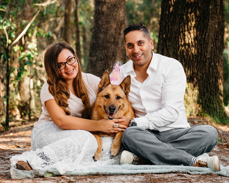 Professional outdoor portrait of a dog and her family taken by Orlando Pet Photography