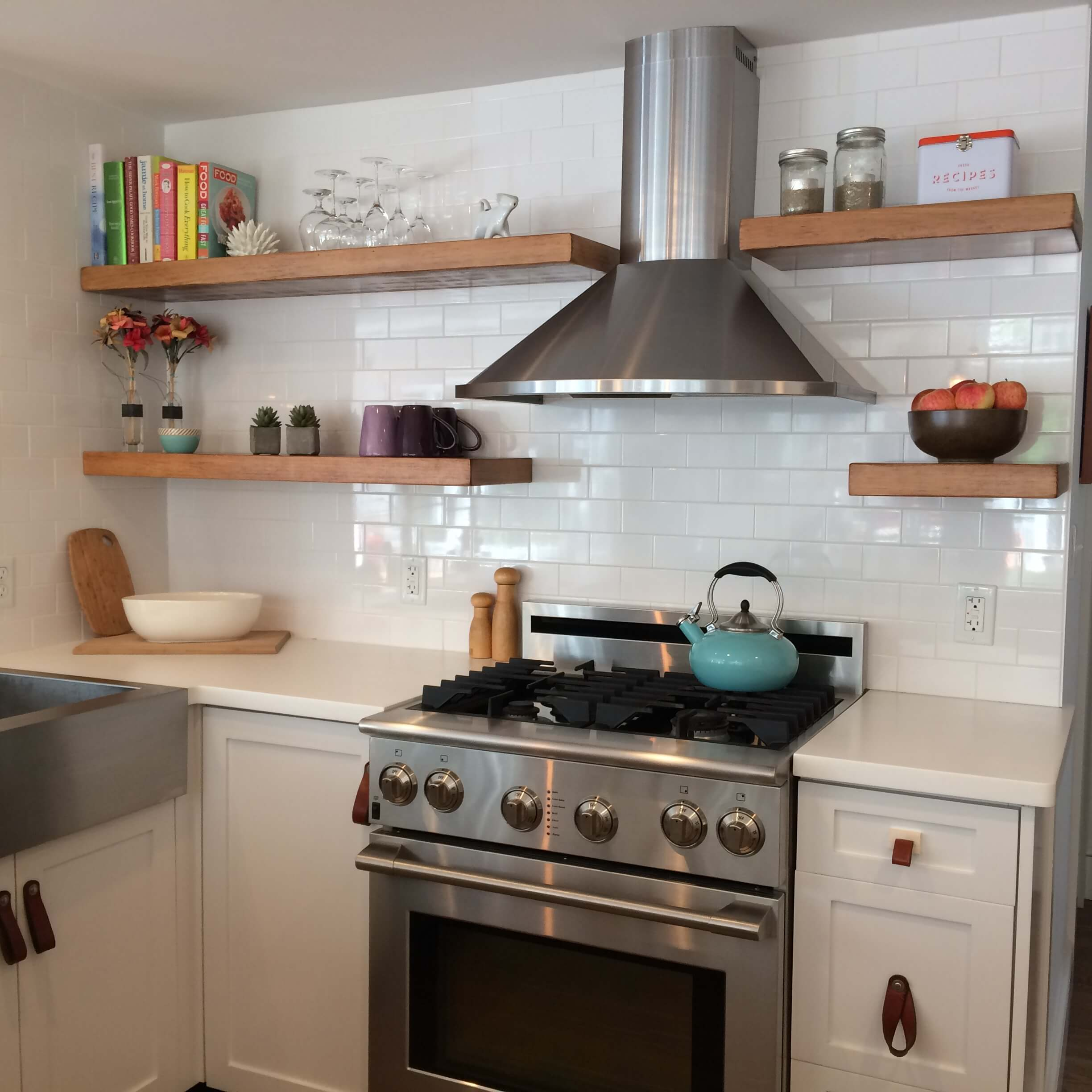 clean white kitchen with floating shelves
