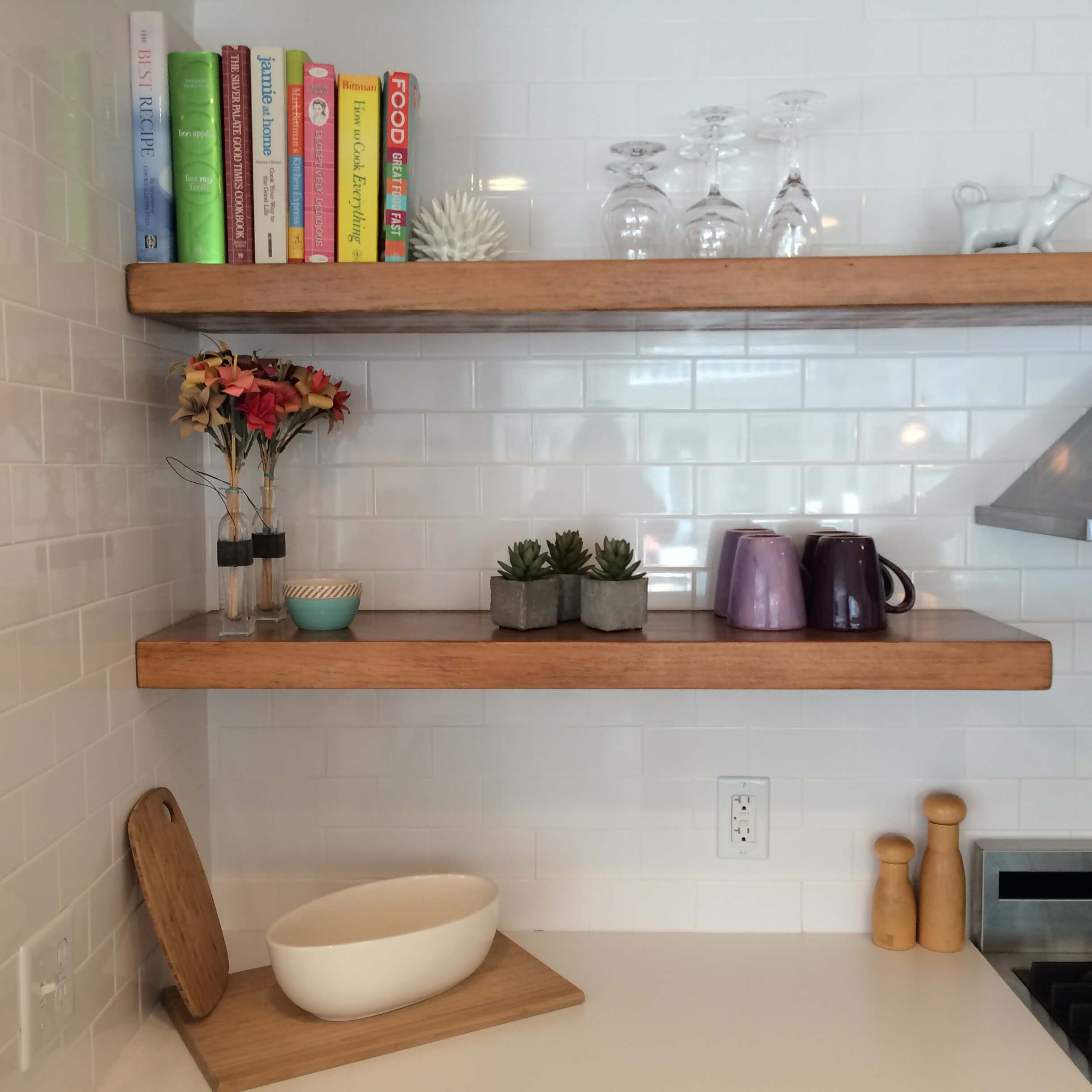floating shelves and white subway tile
