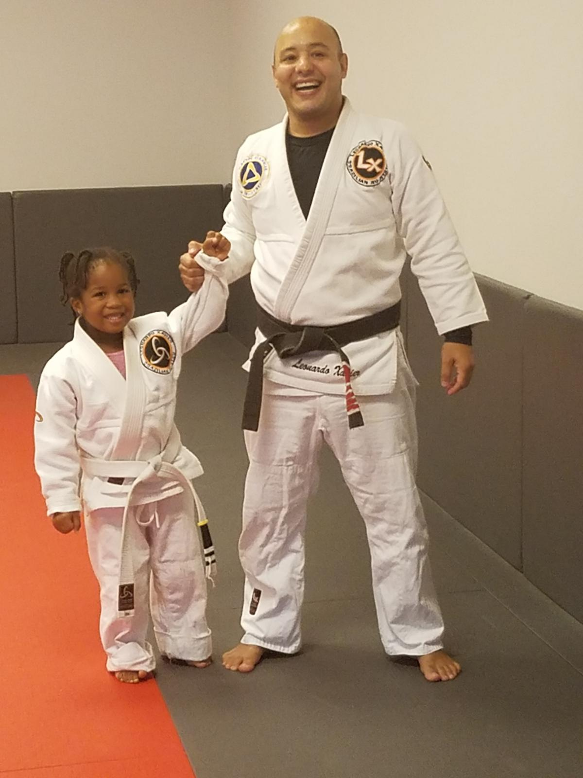"Christian earning a ""stripe"" on her belt - Brazilian jiu-jitsu"