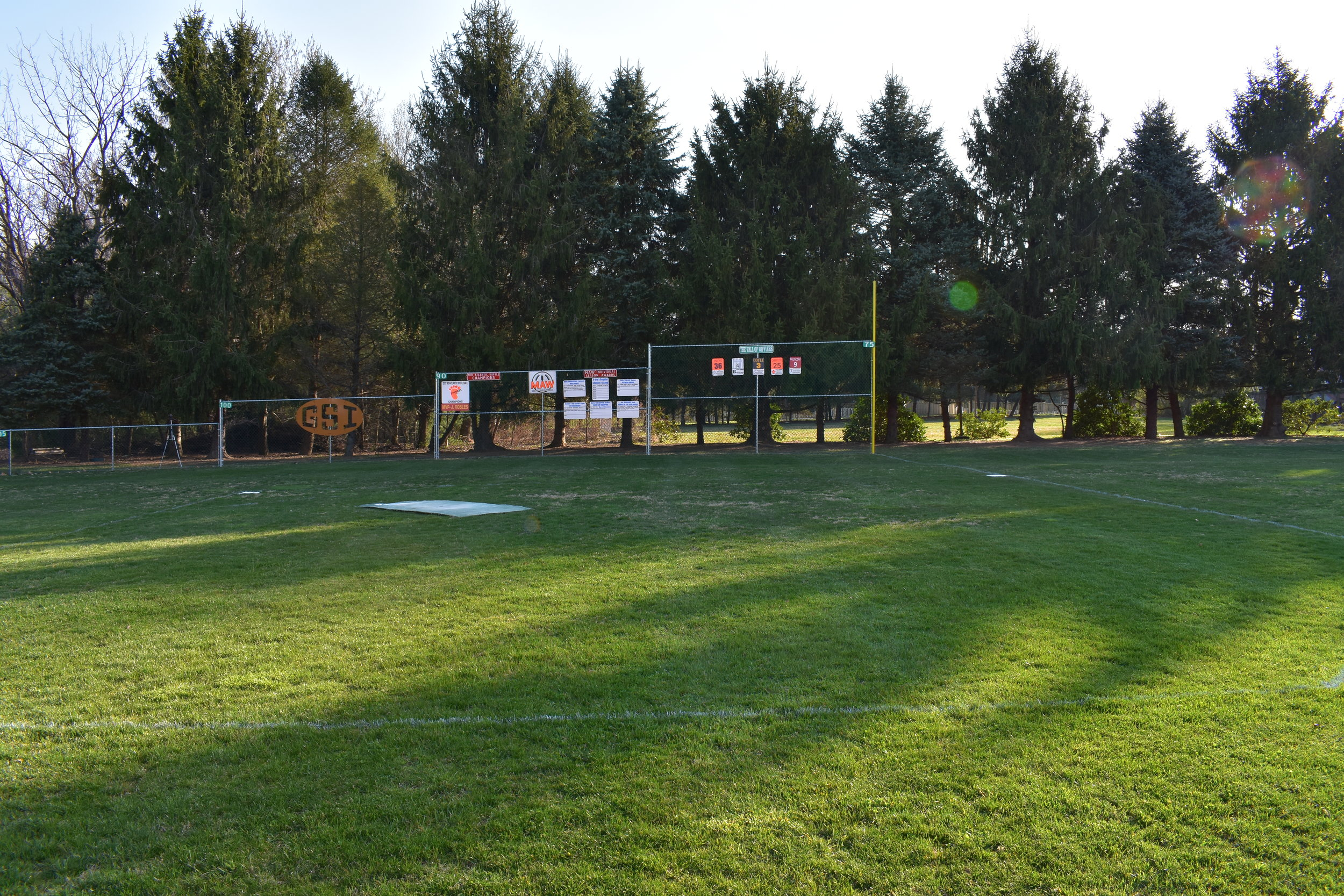 Sheff Field - Built in 2016, Sheff Field is MAW's signature field and is a favorite of all players. The forested backdrop makes for an excellent batter's eye and the field plays relatively wind-neutral. Left field is 87 feet, left center is 100 feet, dead center is 105 feet - all with four foot high fences. Right field is a lefties' dream - just 75 feet but with a 10 foot fence that goes down 2 feet feet in each section of the power alley. Signs to commemorate several regular MAW teams adorn the left field wall. In right field are signs celebrating the accomplishments of prior season award winners and champions, as well as the