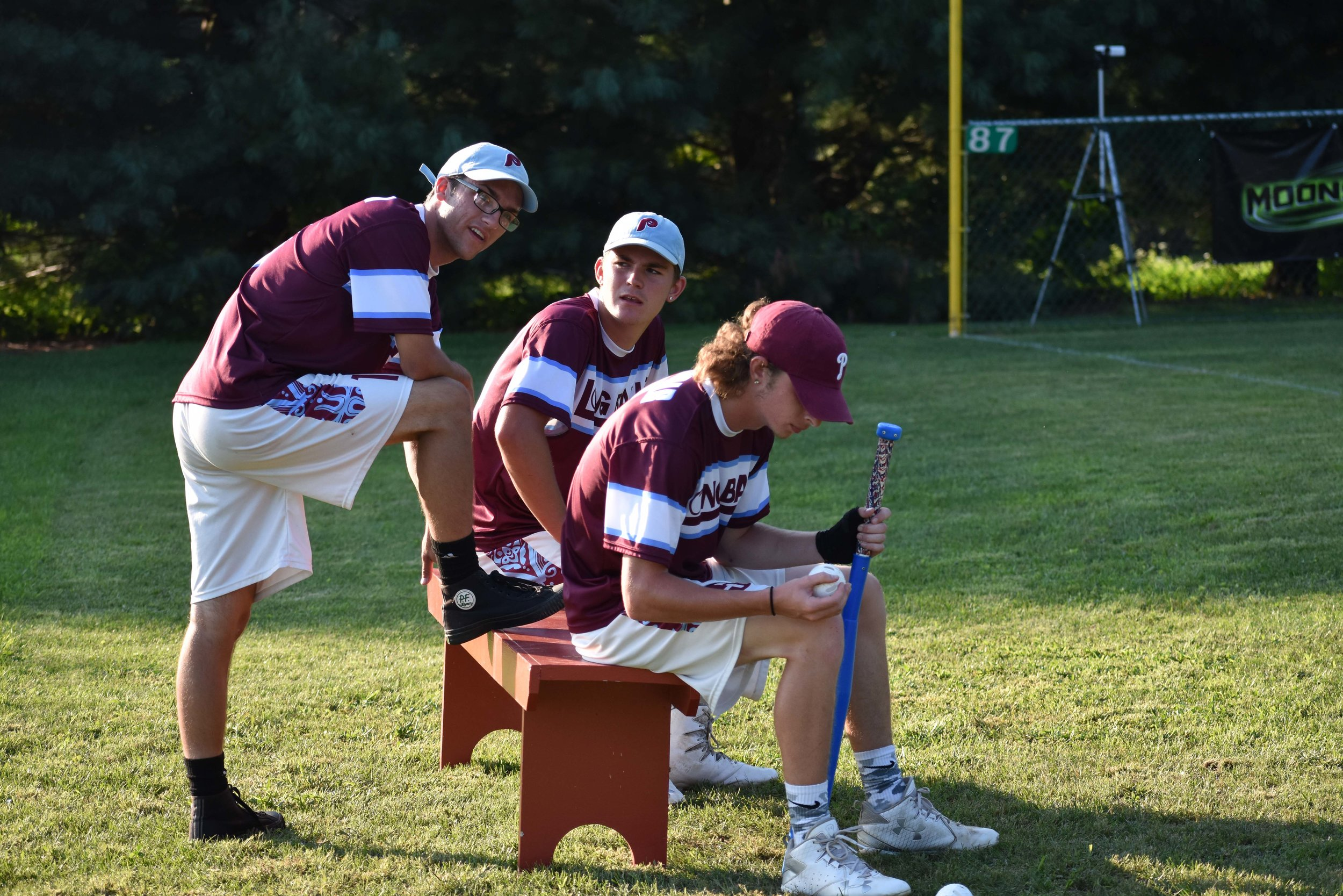 The Longballs' Colin Pollag, Dylan Harshaw, and Tyler Nachbar (left to right) discuss strategy during the tournament championship.