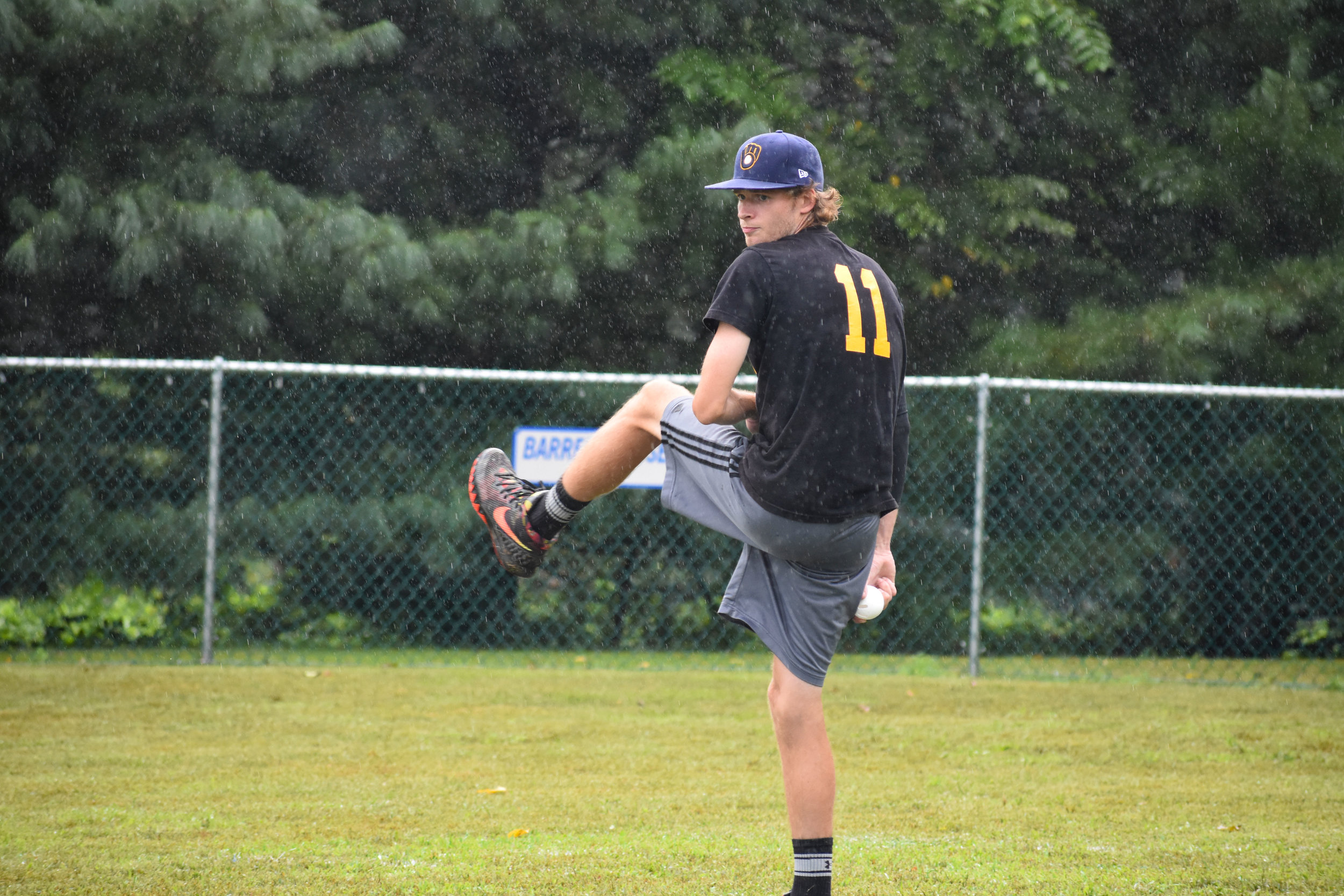 With a steady rain falling around him, Connor Young (My Name is ERL) goes into his patented windup.