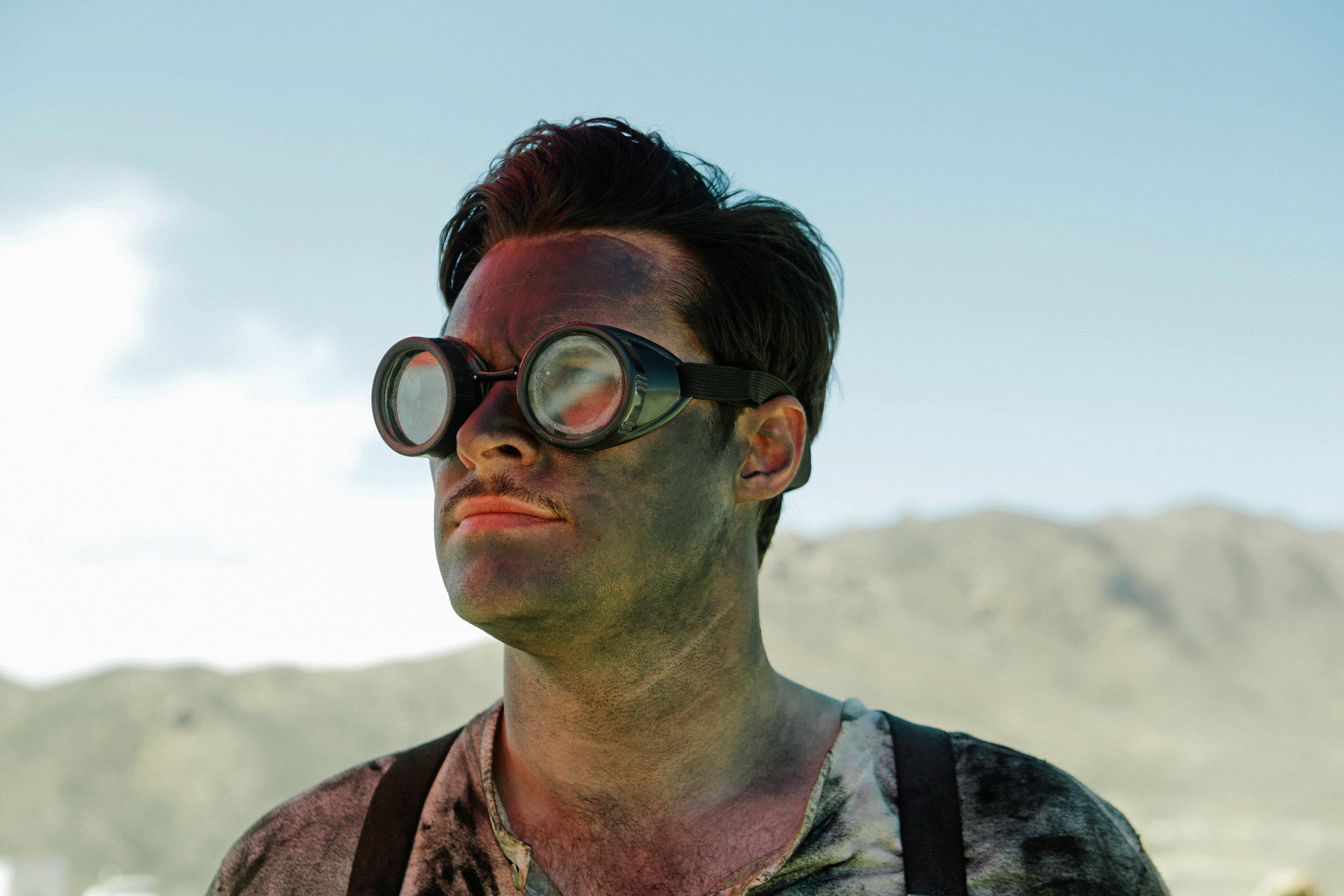 Jack Reynor as Jack Parsons  desert goggles  Strange Angel Season 01.jpg