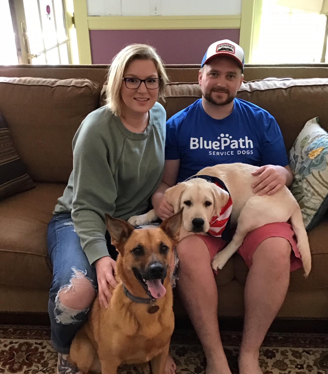 Kaete, Andy and their pet dog, Kota, welcomed BluePath Nicholas into their home with open arms (and laps!).