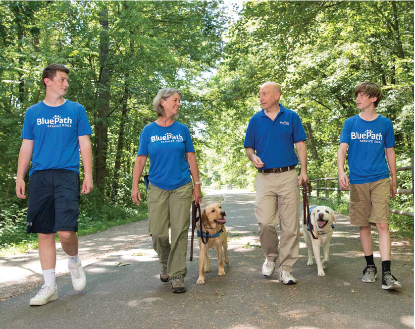 Connor, Caroline, Jody and Evan take a stroll on the Rail Trail with BluePath Benni and pet dog, Kermit.
