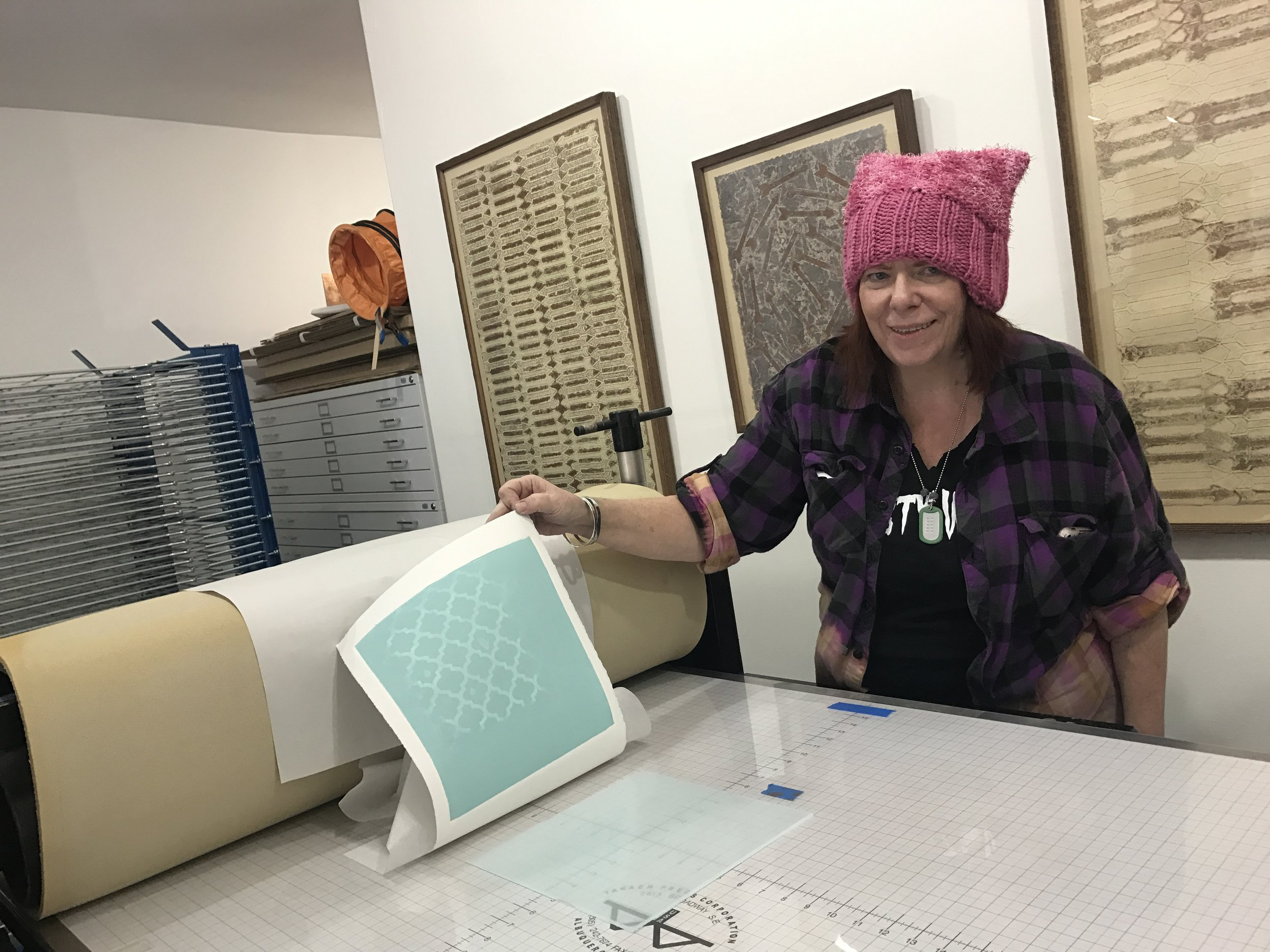 Karen, showing of her print and marcing hat!