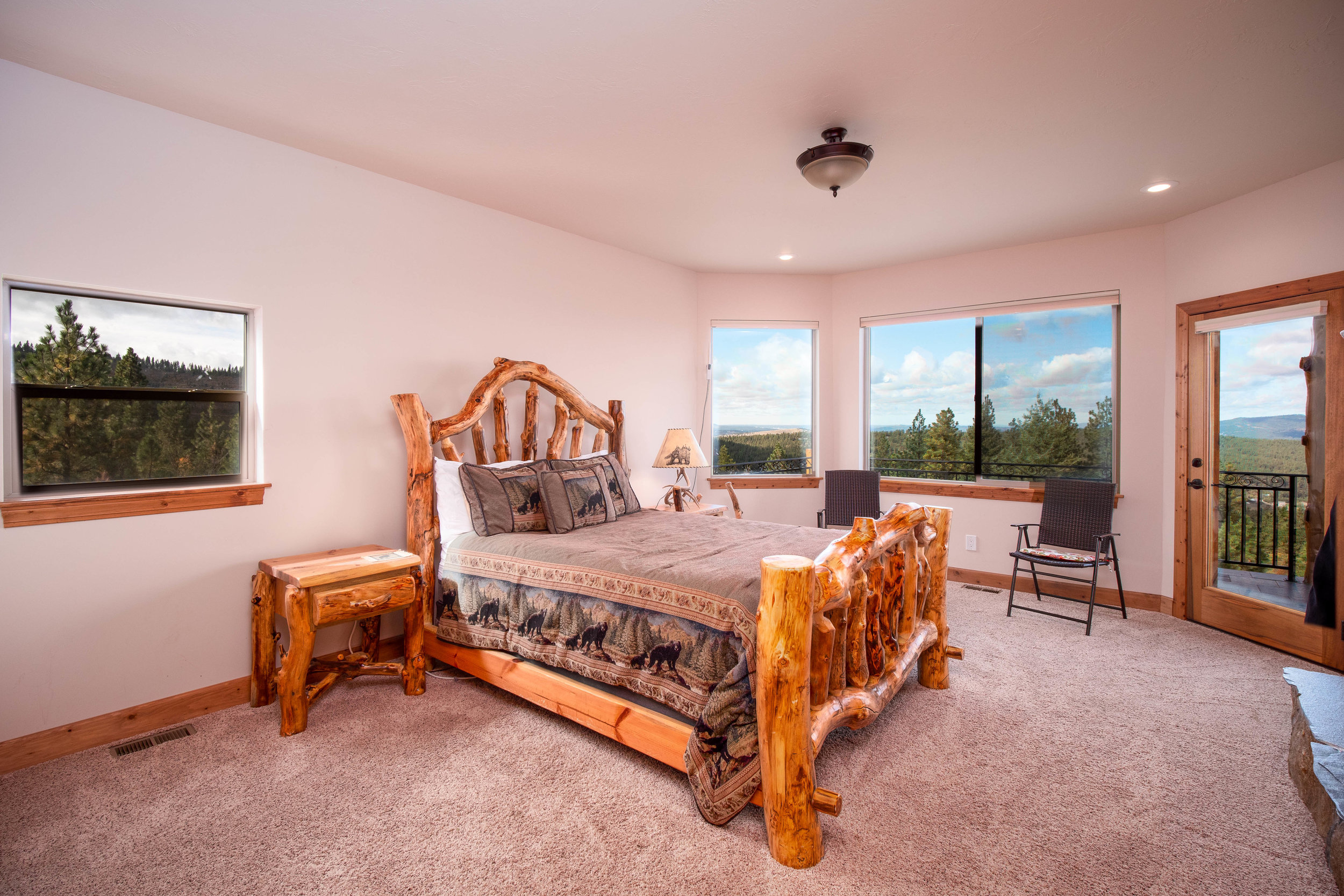 One of several spacious bedrooms with its own private bathroom. There isn't a window in the lodge with a bad view.