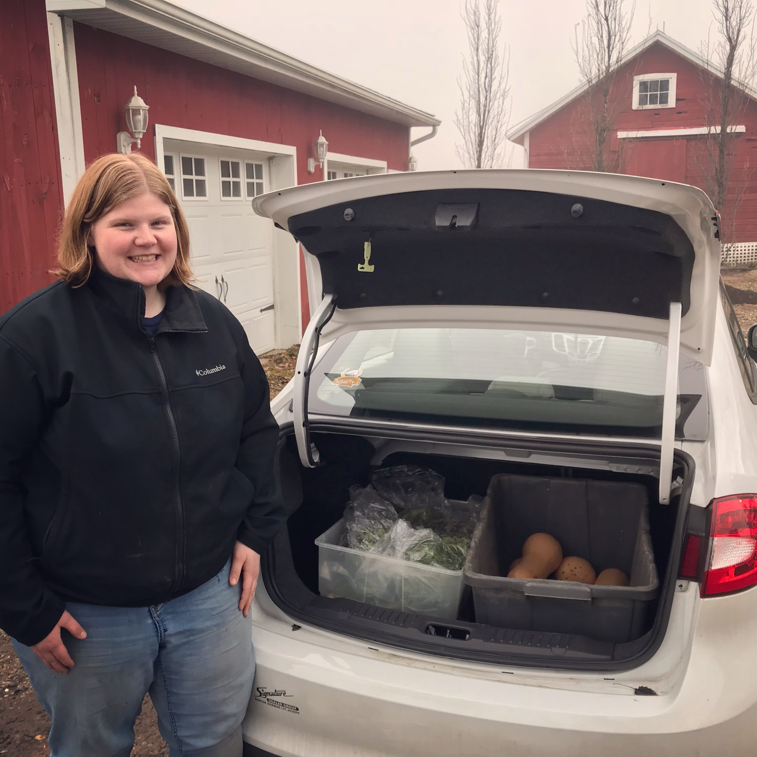 Mary from Harbor Country Mission picking up some early December produce
