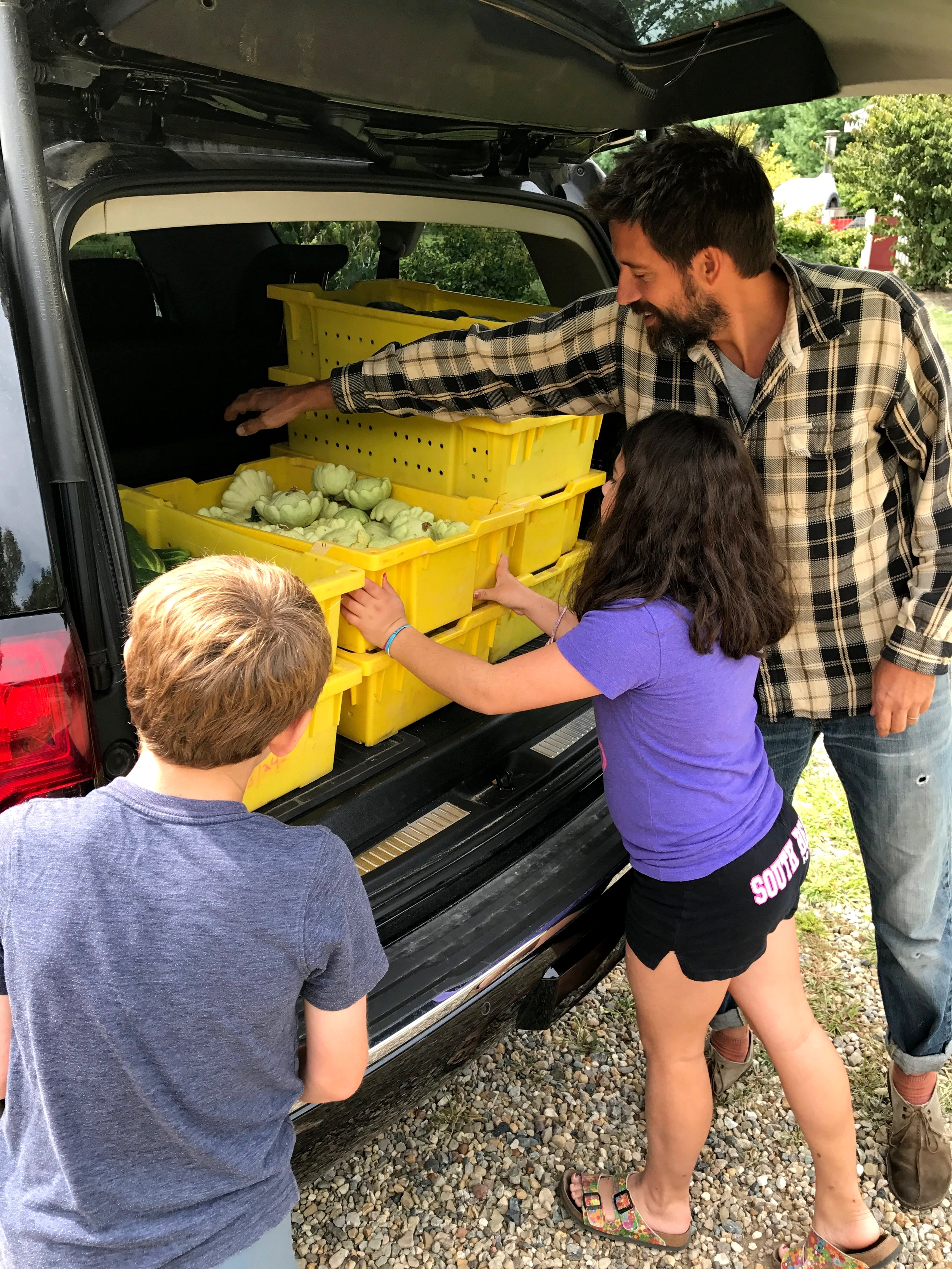Farmer Billy and the Harris twins loading up a late summer produce donation