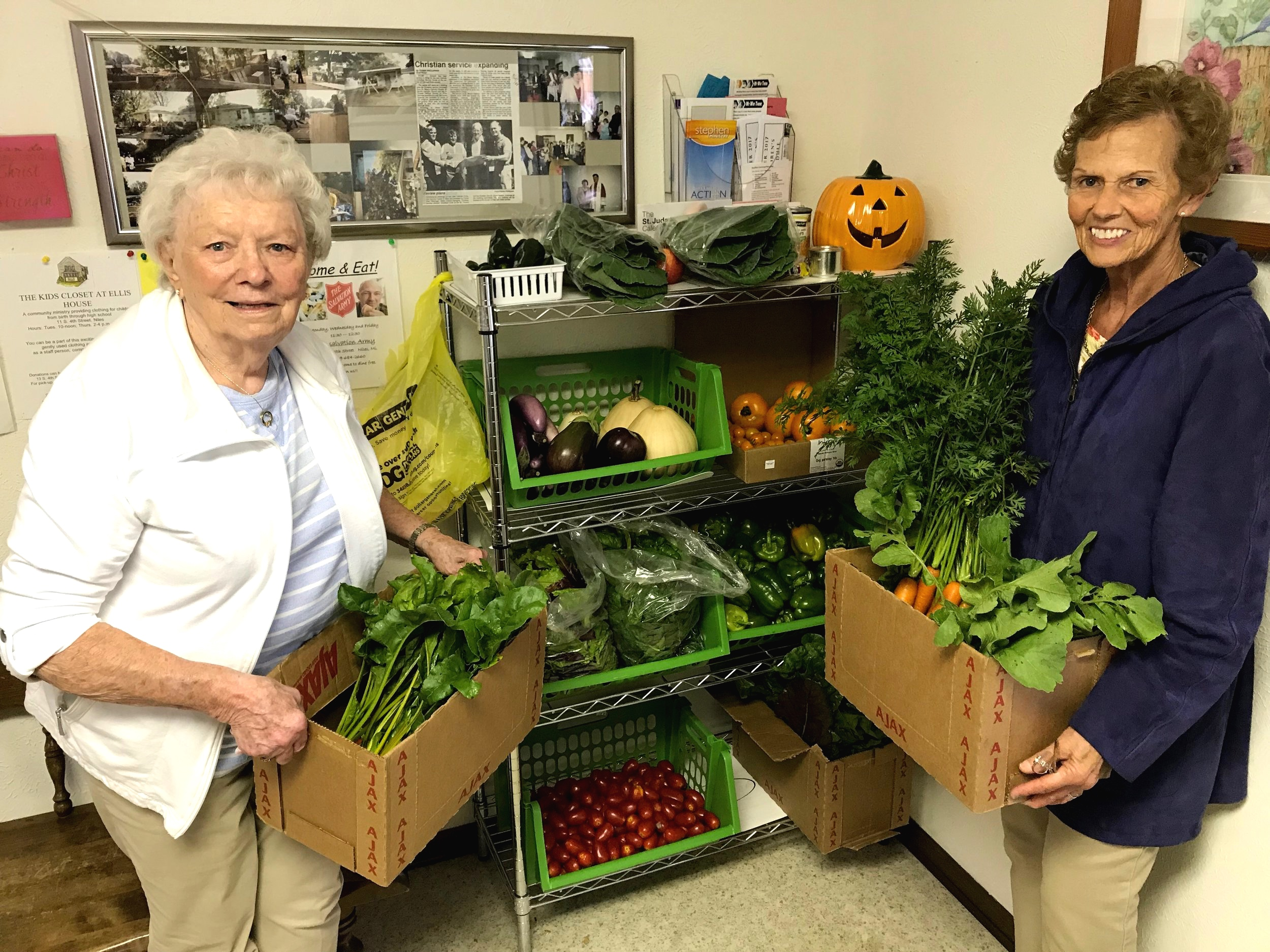 The lovely volunteers of St Mary's food pantry in Niles finding shelf space for HFFF donations
