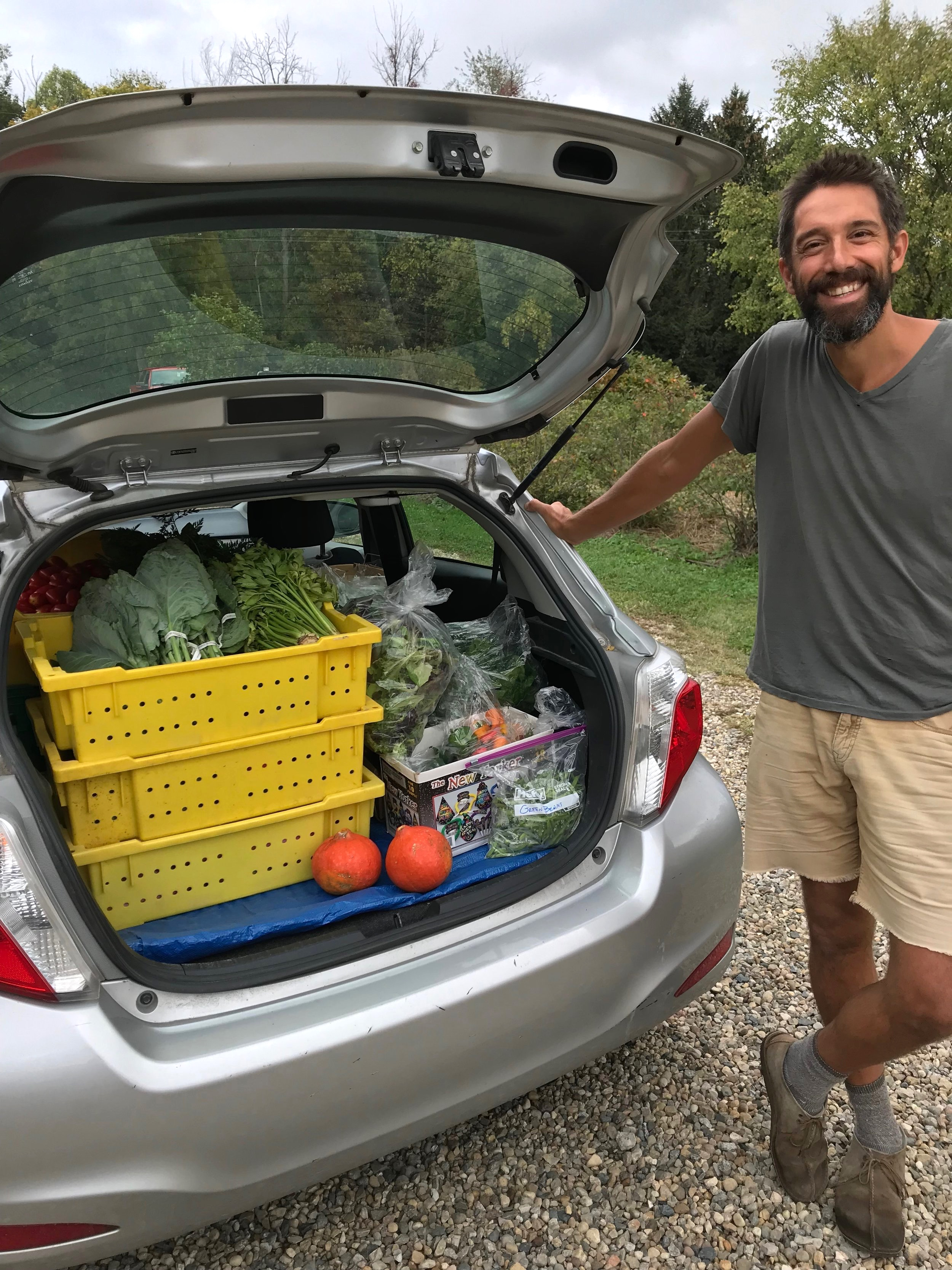 Farmer Billy with a carload of produce donations