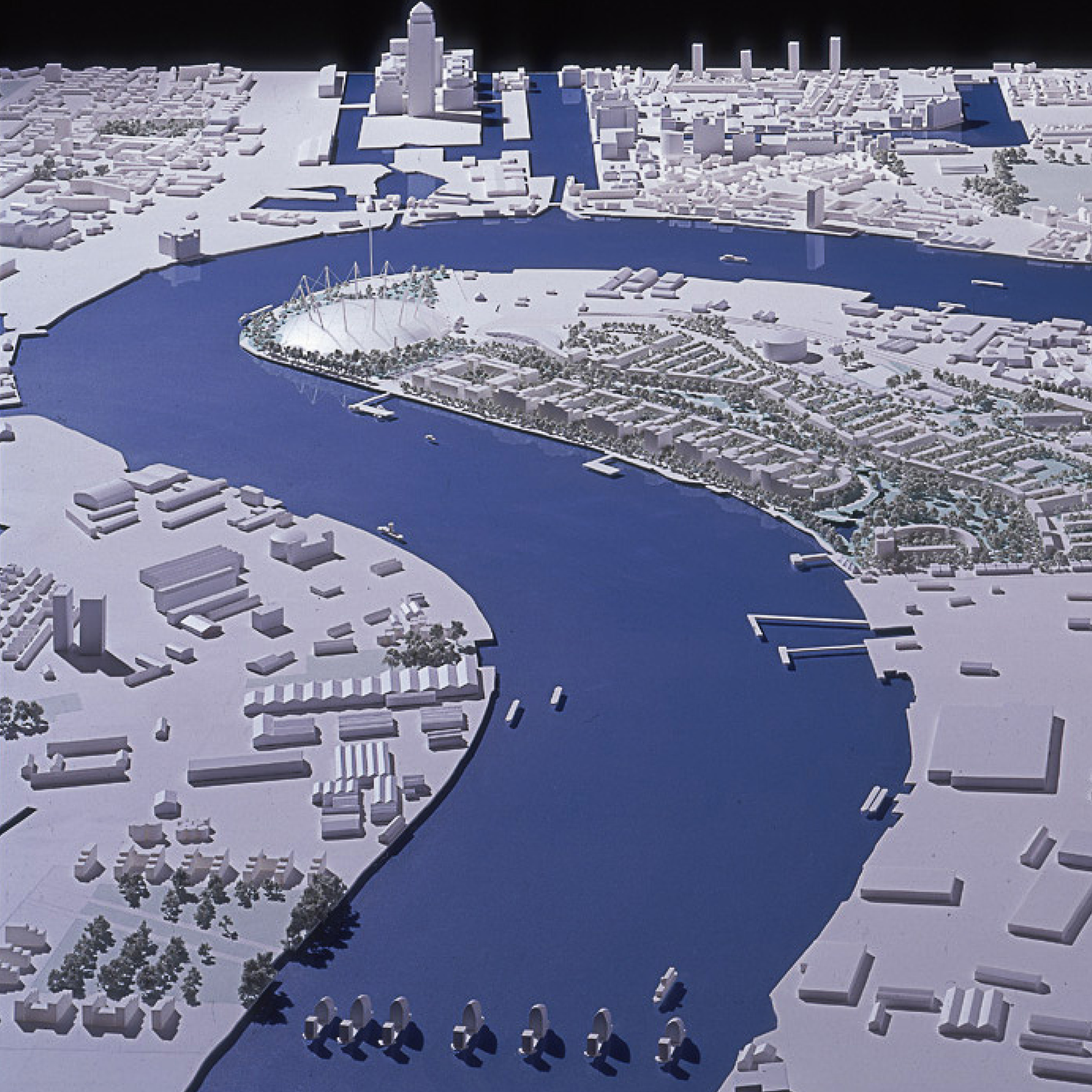 Physical model of the Millennium Dome project in the context of the Greenwich Peninsula masterplan. The Thames Barrier is in the foregreound and Canary Wharf in the background.