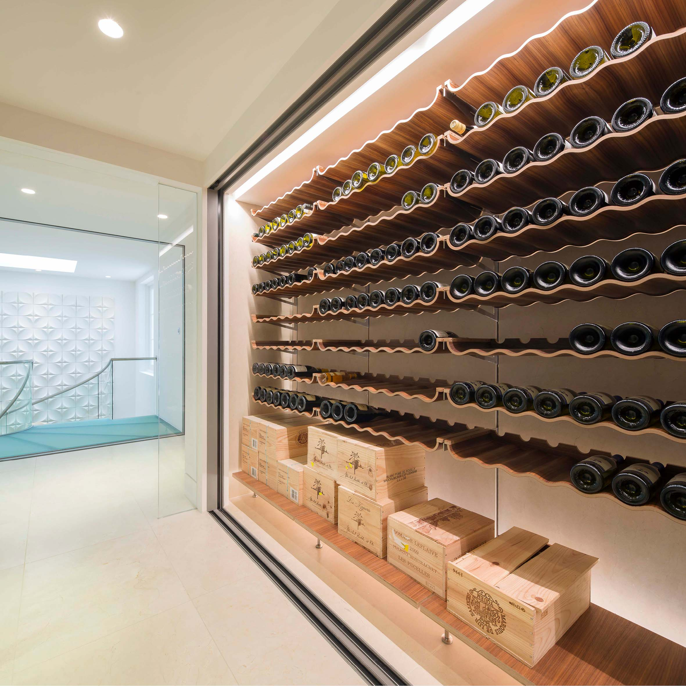 The 200 bottle wine store linking the main house to the swiming pool.